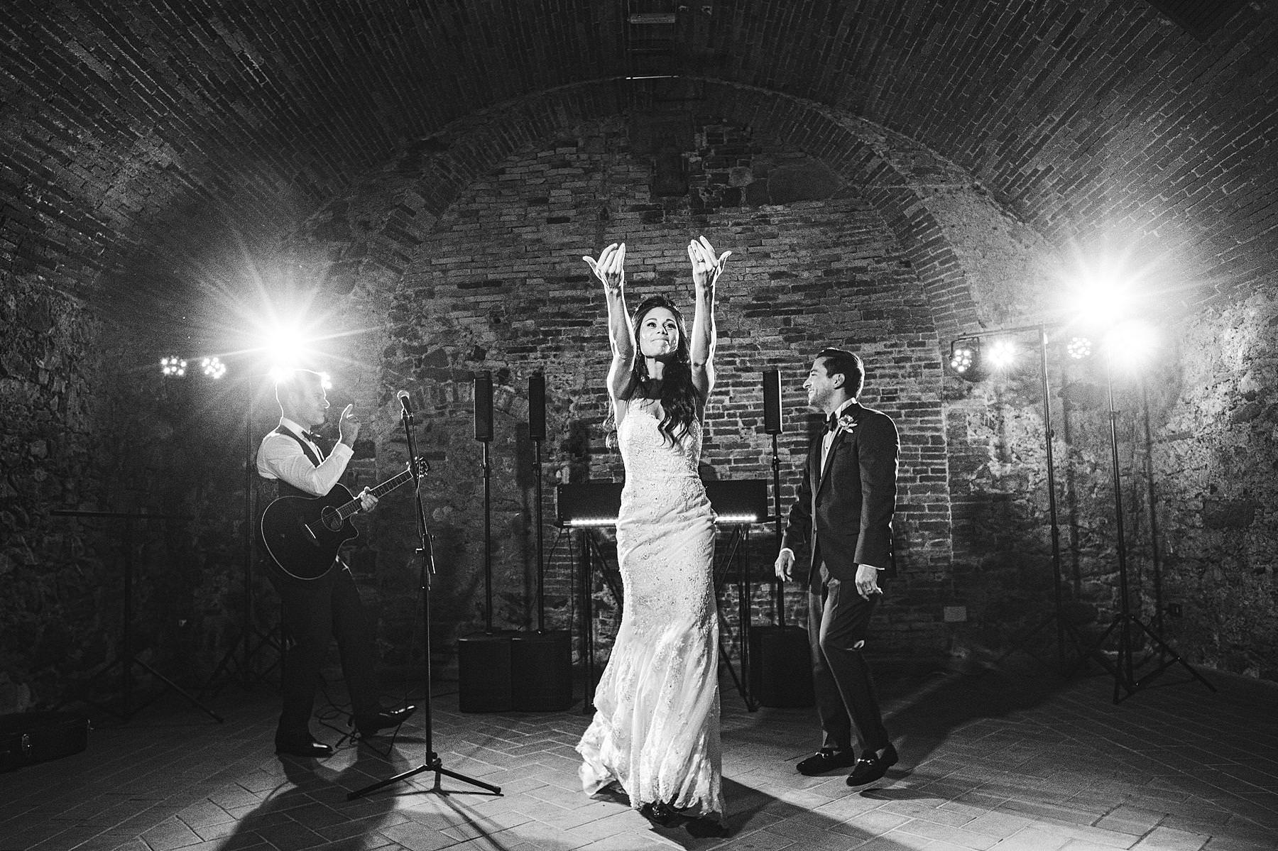 Bride groom dancing party at historic estate of Villa La Selva in the countryside of Tuscany