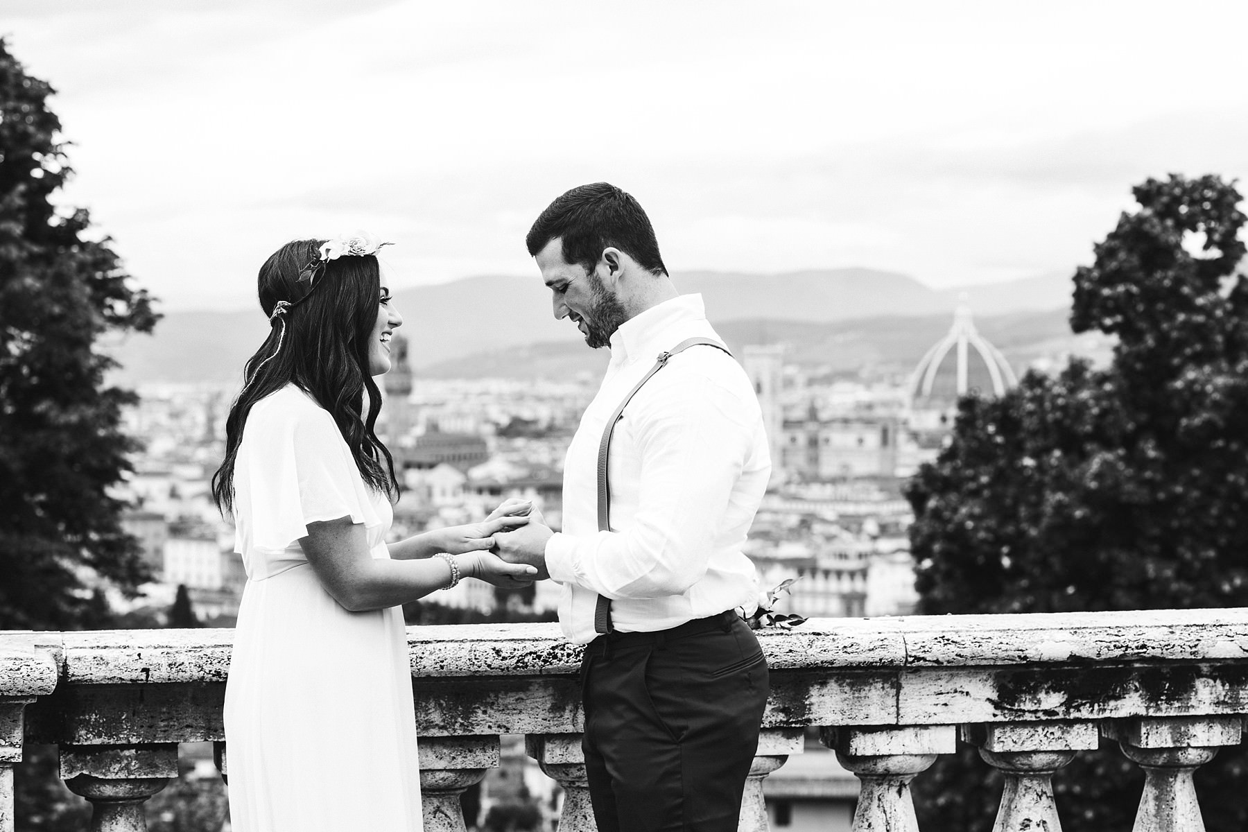 Dream elopement photo shoot in Florence. Exchanging of the ring with Florence Dome as background
