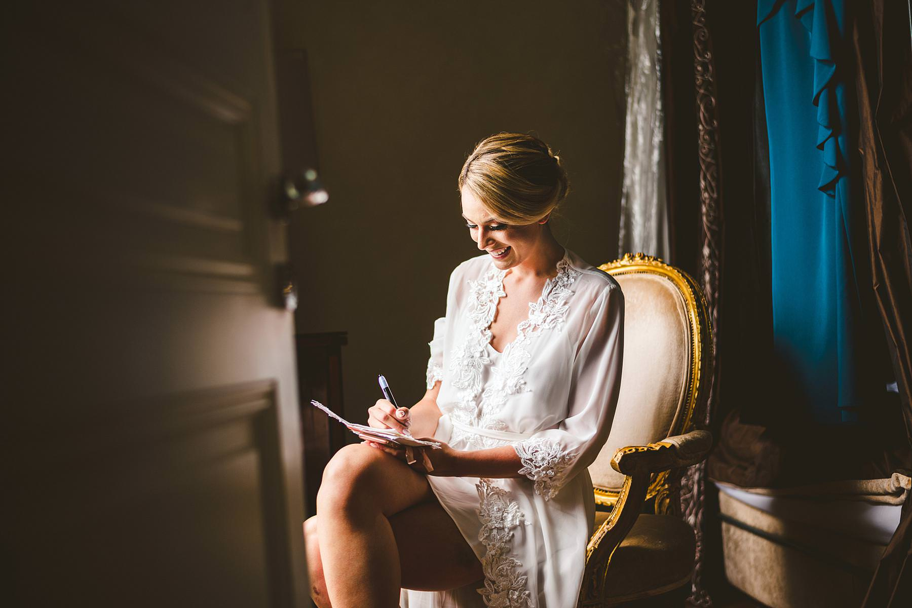 Lovely bride Christina write wedding vows just before the intimate outdoor wedding ceremony at Villa La Vedetta, Florence