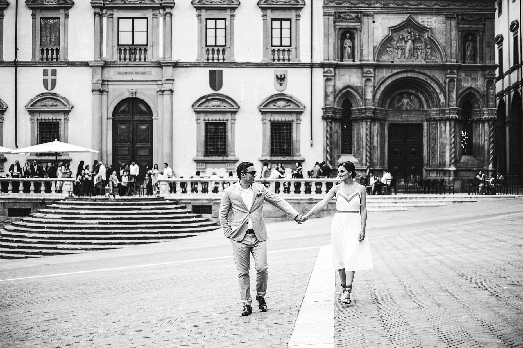 Destination wedding in Arezzo. Bride and groom prewedding couple portrait photo shoot at Piazza Grande during welcome dinner