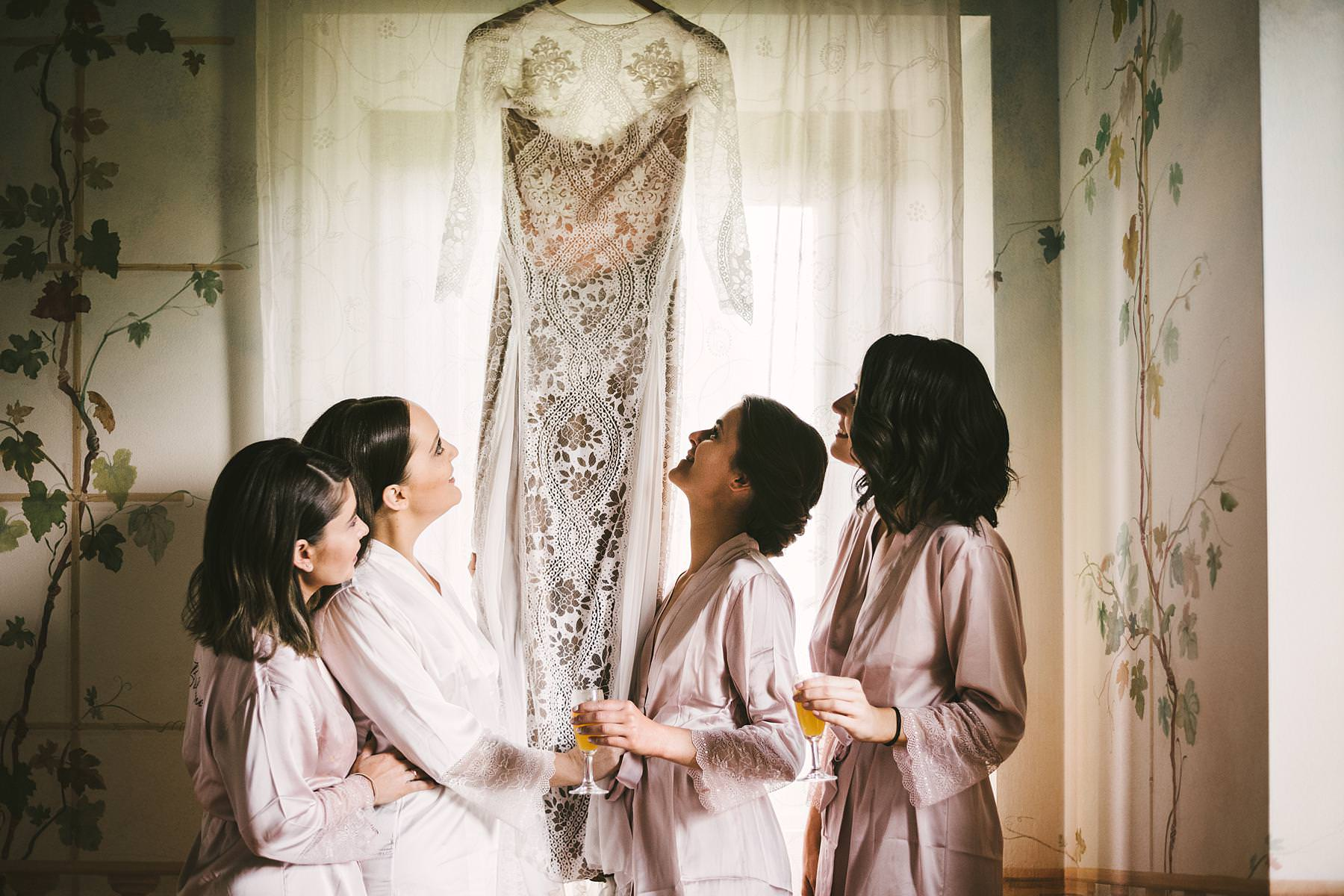 Lovely bride and bridesmaids with a gorgeous Grace Loves Lace wedding gown at Villa lÕAntica Posta. Elegant destination wedding in Umbria