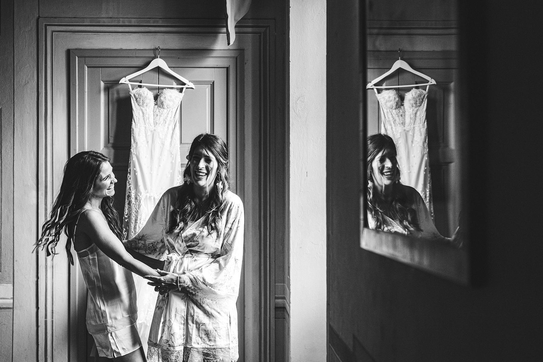 Lovely moment with bride and bridesmaid during getting ready at Villa Il Poggiale. Destination wedding in Tuscany countryside of Chianti