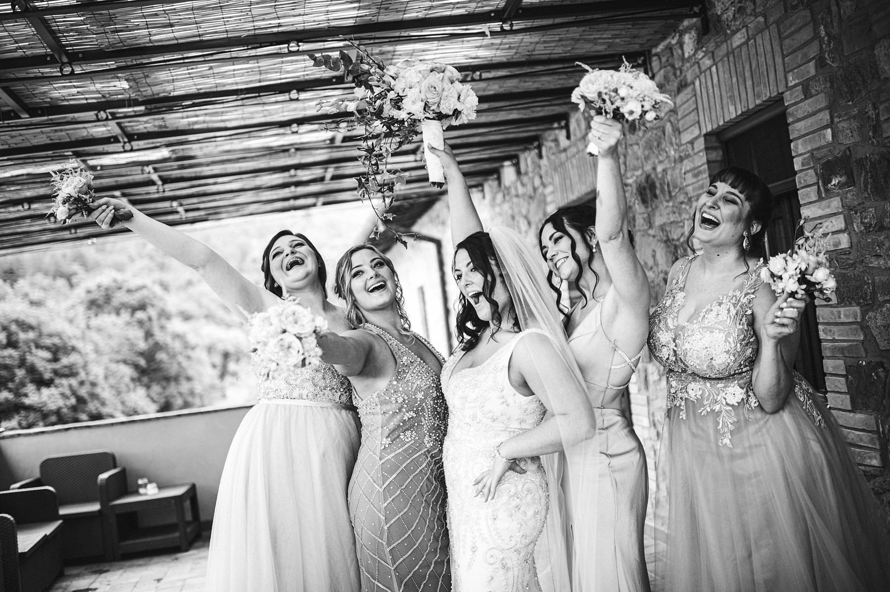 Exciting bridal party wedding photo at Villa Le Bolli, Tuscany