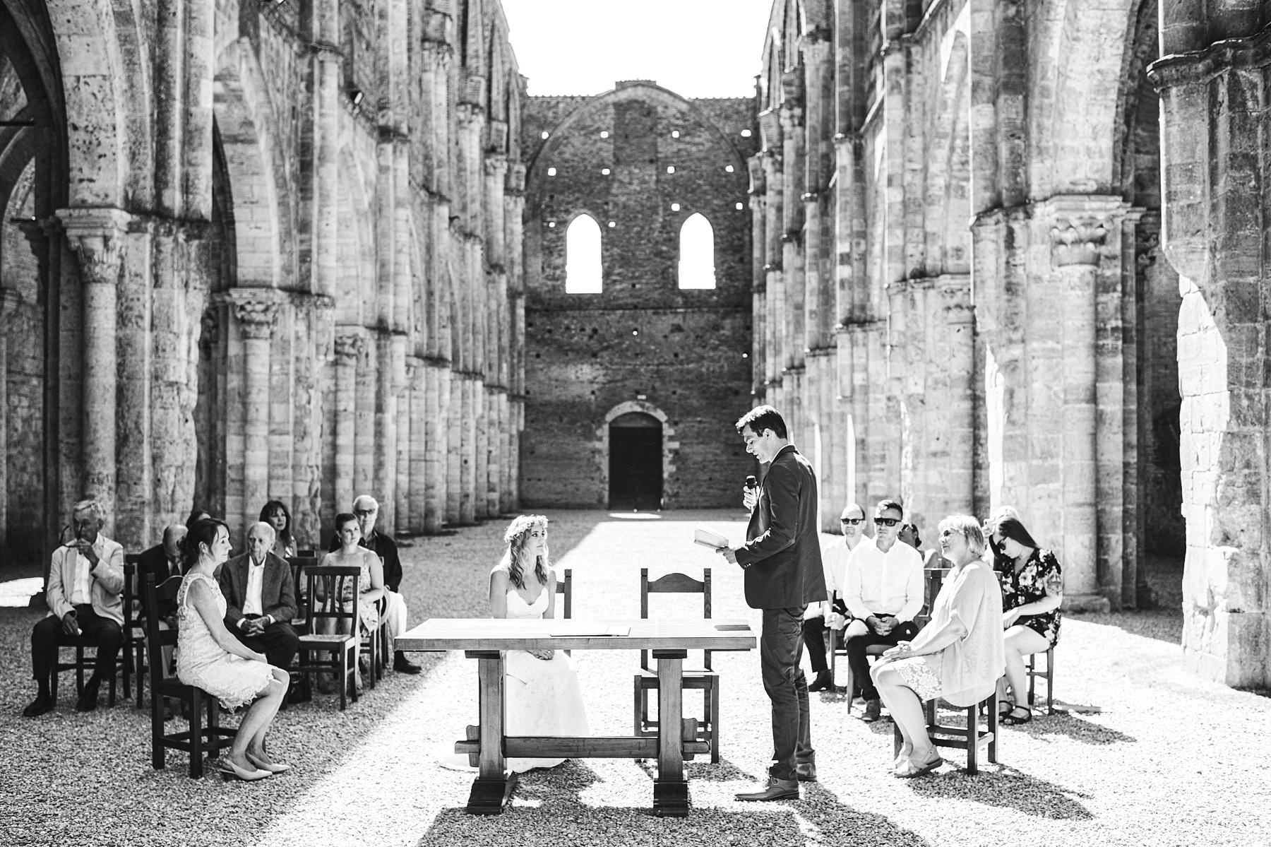 Amelia and Casey's small civil marriage in Italy at roofless abbey of San Galgano