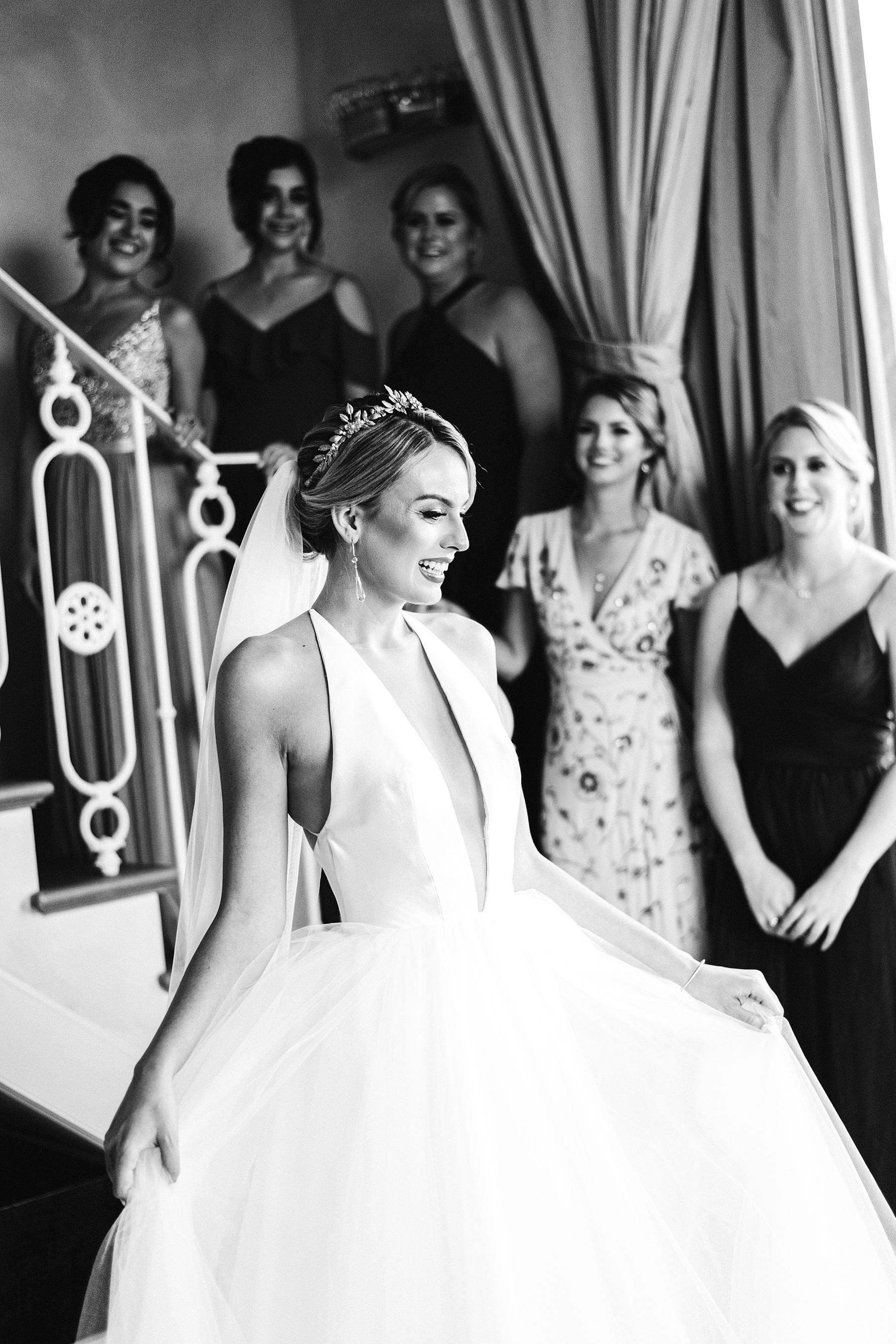 Bride with bridesmaids during the getting ready in the suite of Villa La Vedetta, Florence. Luxury destination wedding in Florence
