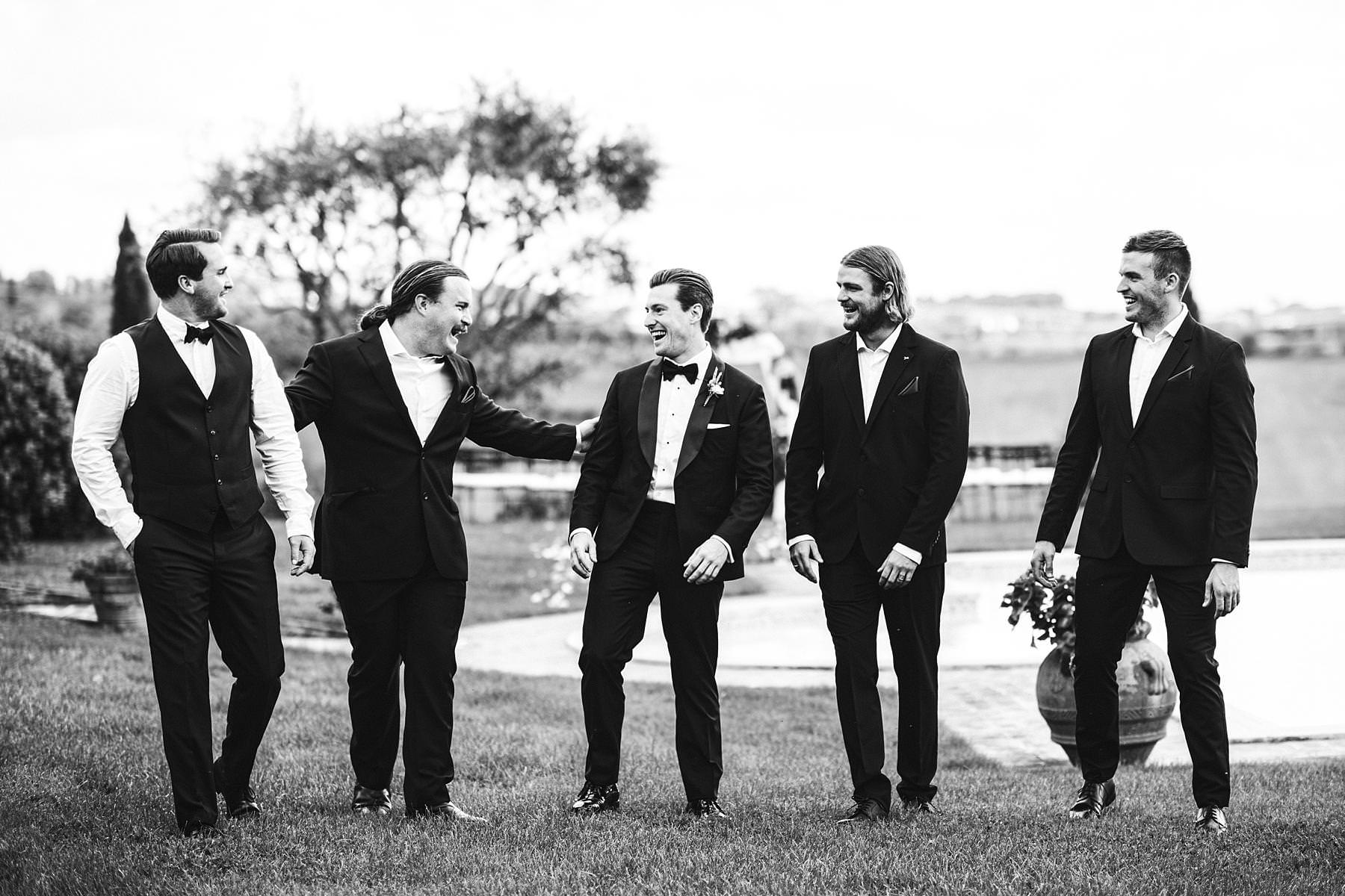 Exciting groom and groomsmen photo shoot just read for the intimate wedding ceremony at Villa l'Antica Posta in Umbria
