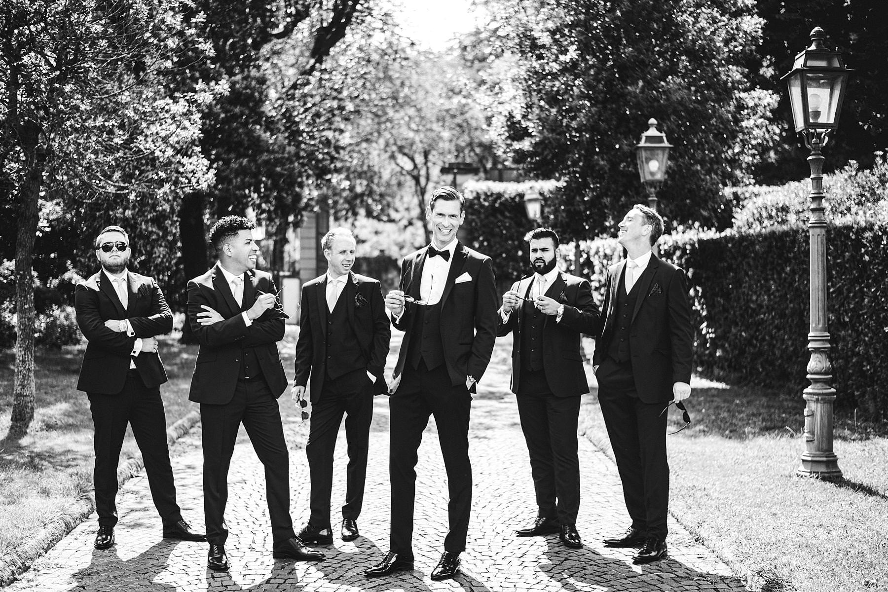 Groom Cheyne with groomsmen at Villa La Vedetta, Florence just before the wedding ceremony in the park of the Villa