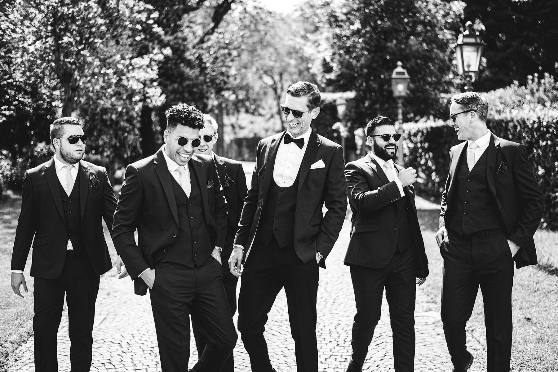 Exciting groom and mens just before the outdoor wedding ceremony hosted at Villa La Vedetta, Florence. Intimate luxury destination wedding