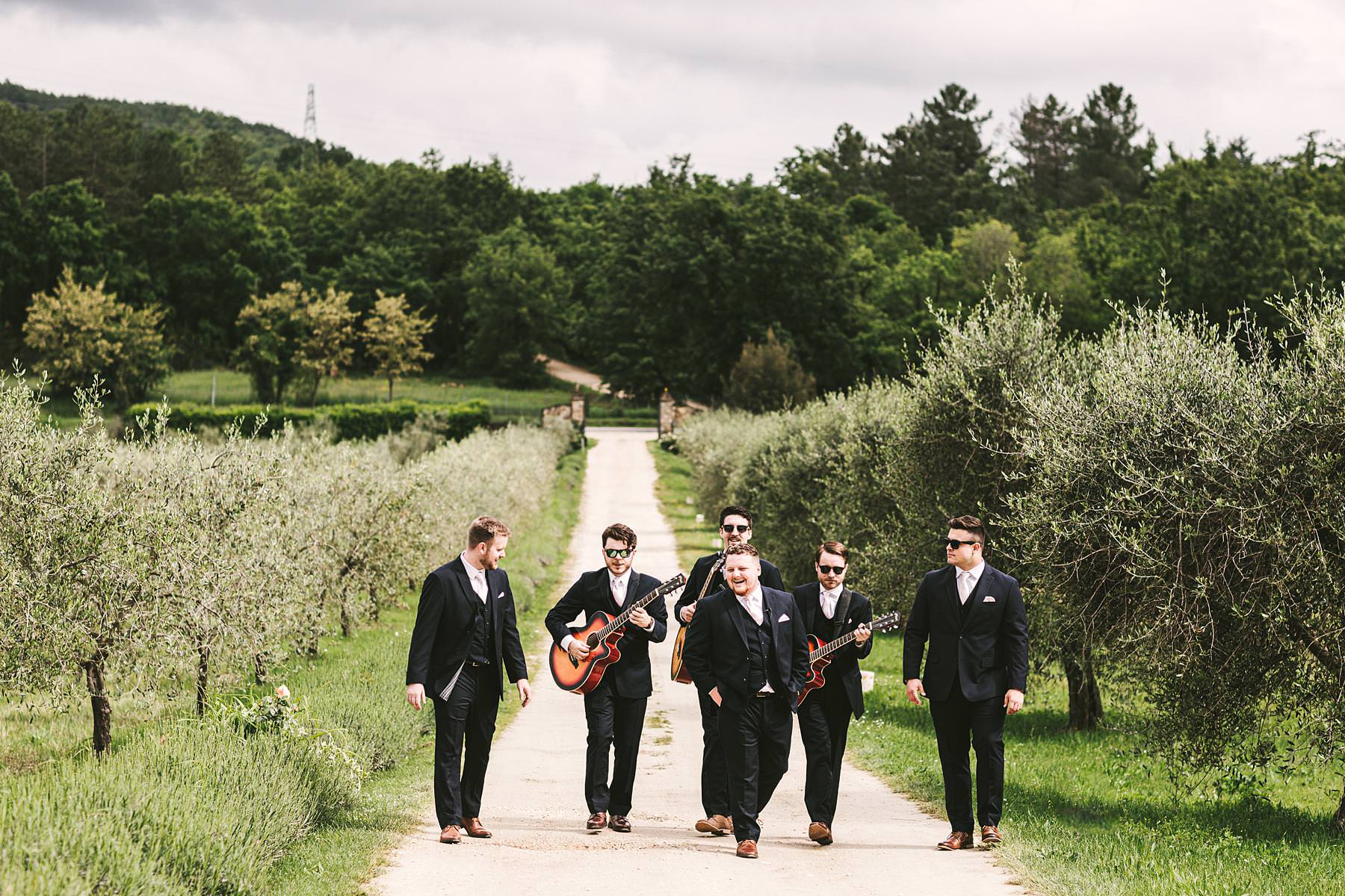 Groom and mens just ready for the outdoor intimate destination wedding ceremony in Tuscany countryside venue of Villa Le Bolli near Radicondoli