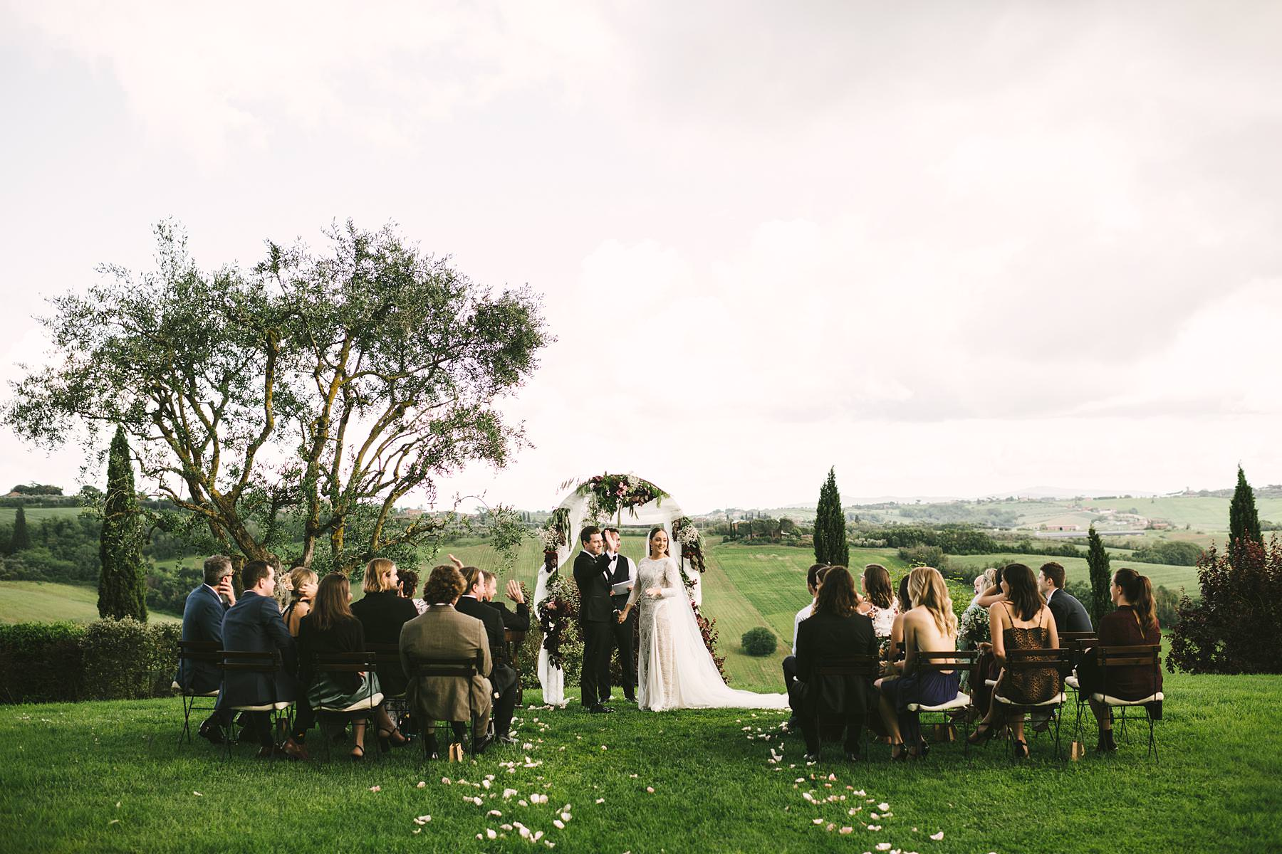 Unforgettable elegant outdoor intimate wedding ceremony in Umbria at incredible historic venue of Villa lÕAntica Posta with gorgeous countryside panoramic view