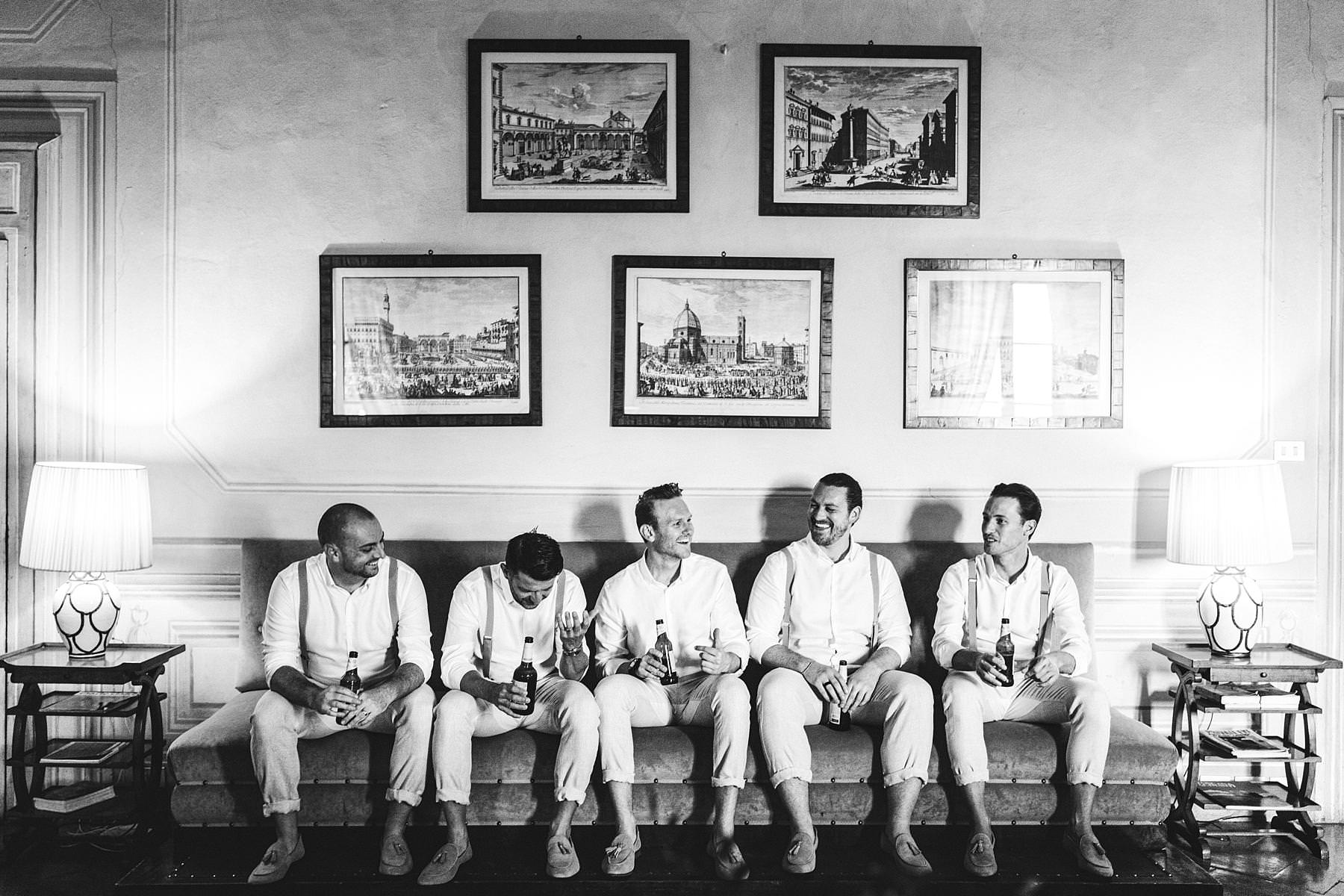 Elegant groom with groomsmen wedding photo in the historical residence of Villa Il Poggiale in Chianti