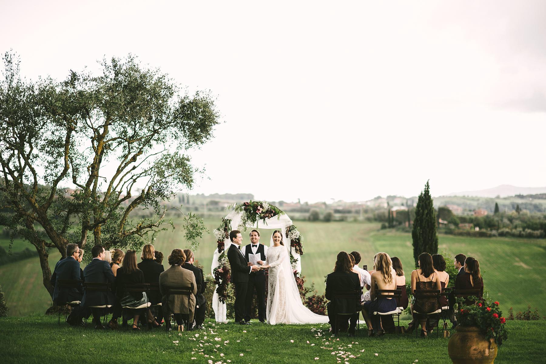 Elegant intimate destination outdoor symbolic wedding with amazing landscape in Umbria countryside at incredible historic venue Villa l'Antica Posta