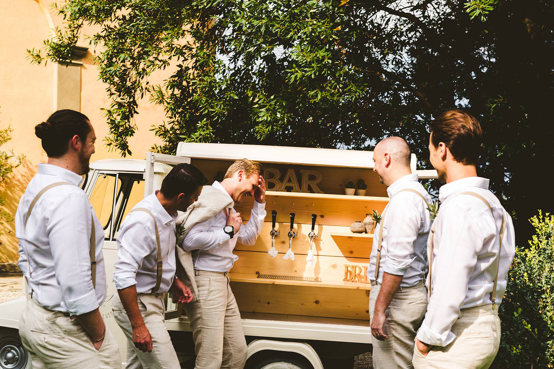 Exciting and fun groom with groomsmen wedding photo near Brindapino at Villa Il Poggiale