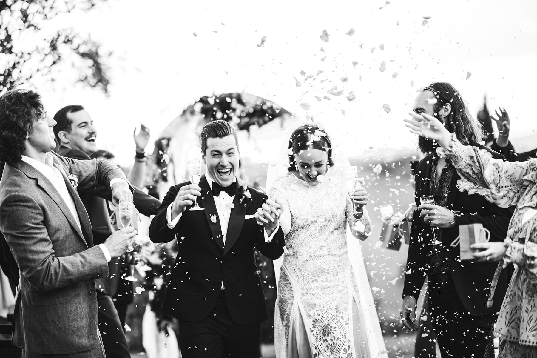Destination wedding in Umbria at Villa l'Antica Posta, elegance and fun in a nutshell. Bride and groom are just married. Incredible intimate destination symbolic wedding