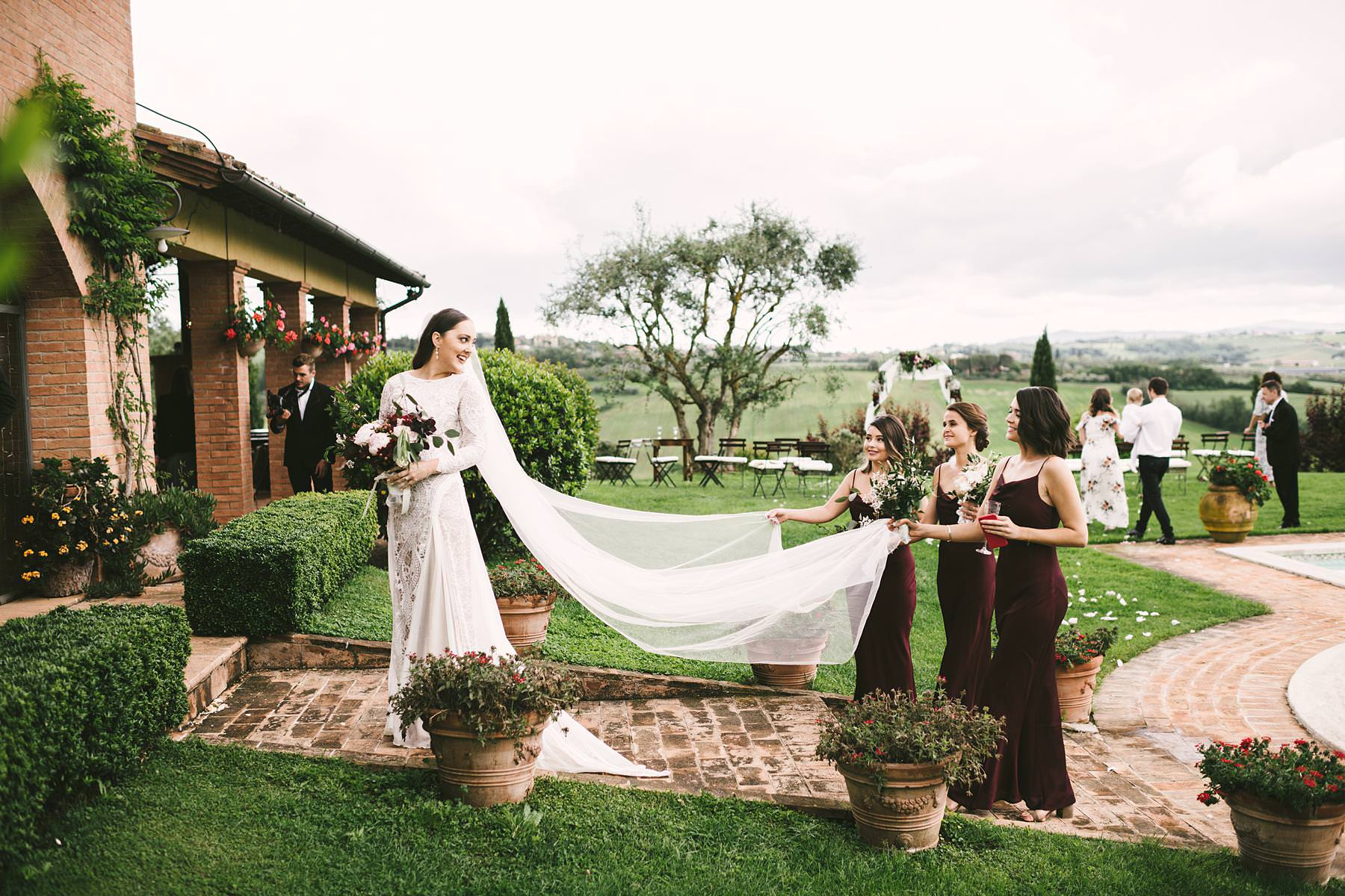 Elegant bride Holly in here Grace Loves Lace wedding gown with bridesmaids. Destination wedding in Umbria at Villa l'Antica Posta