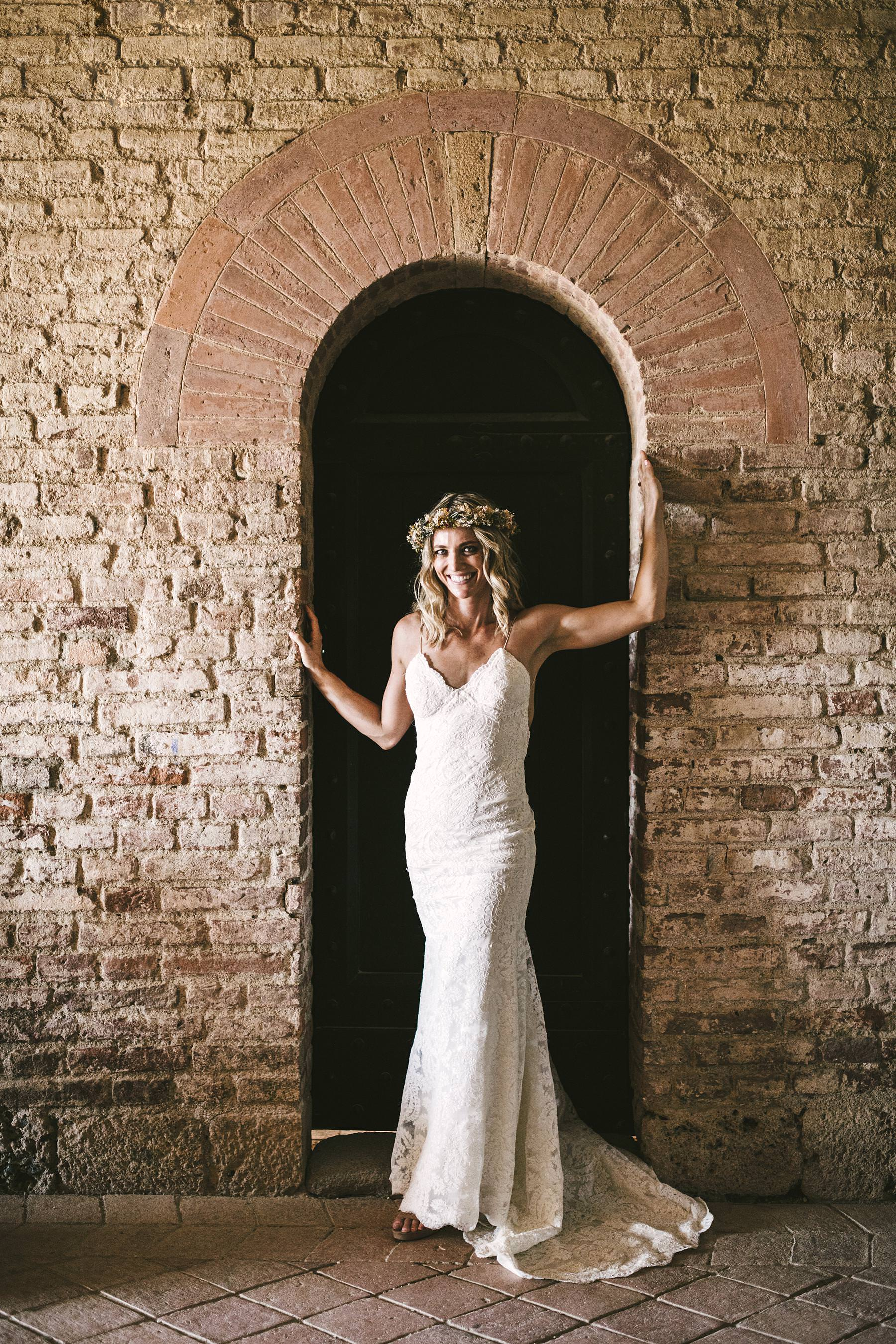 Elegant bride Amelia in Katie May wedding gown at Roofless Abbey of San Galgano. Intimate destination Italian civil marriage