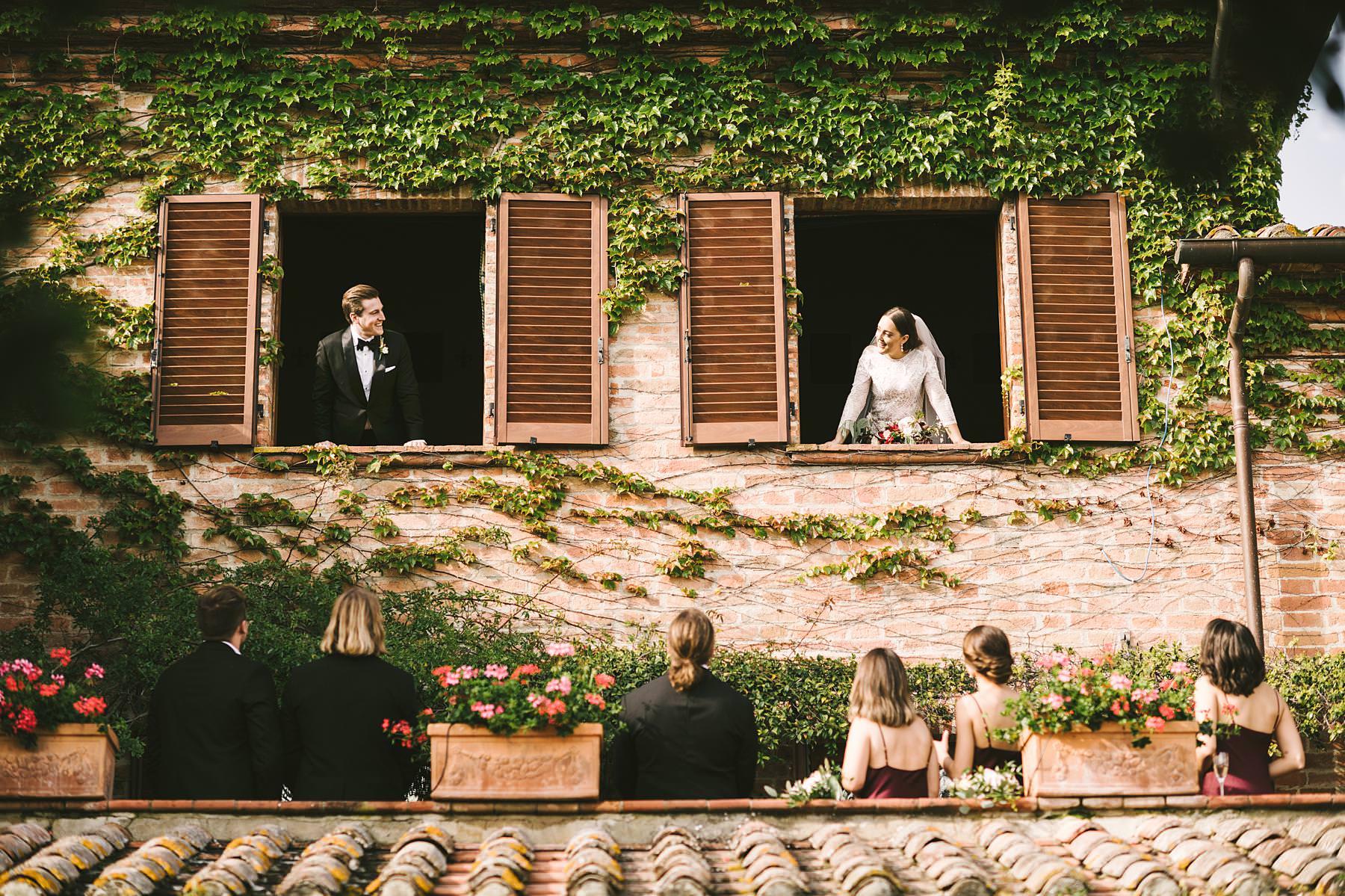 Bride and groom wedding photos with bridal party. Intimate destination wedding in Umbria