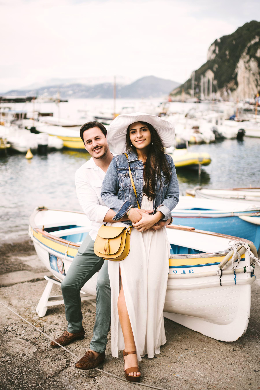 Lovely, elegant and romantic evocative destination engagement pre-wedding couple portrait photo shoot in the tourist port of Capri