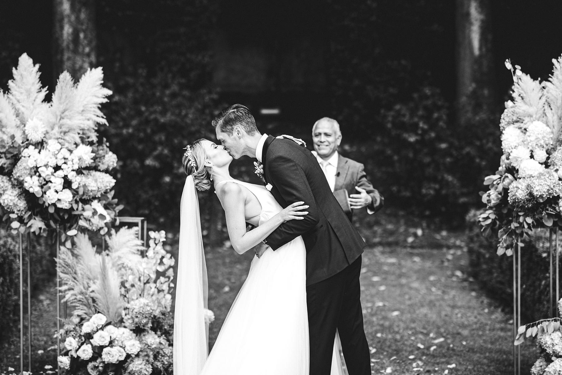 Timeless wedding celebration. Lovely moment of bride and groom in the garden of Villa La Vedetta, Florence