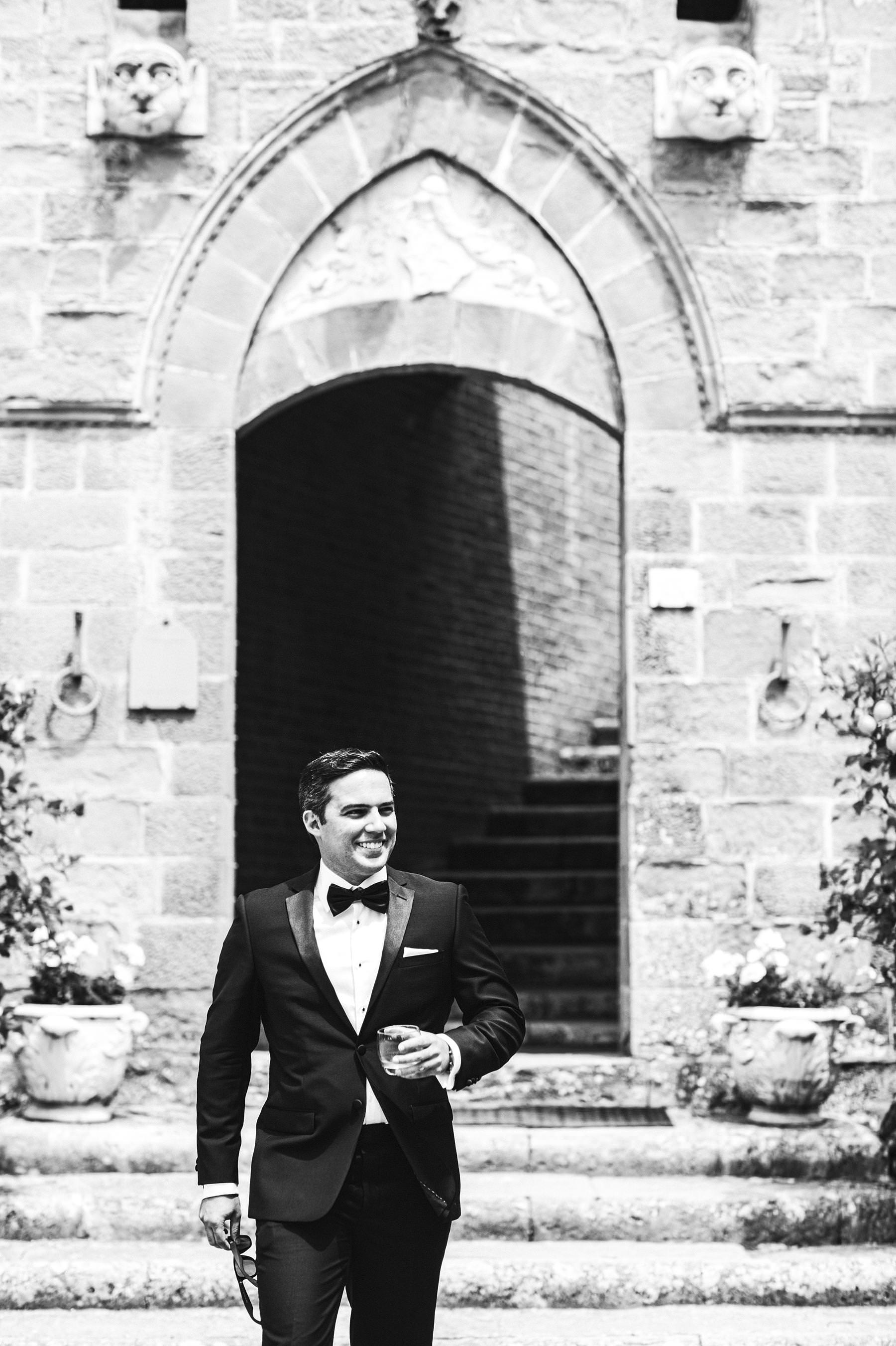 Rippling and sumptuous Tuscany wedding in the elegant Castle of Valenzano. Elegant groom Alex just ready to the wedding ceremony