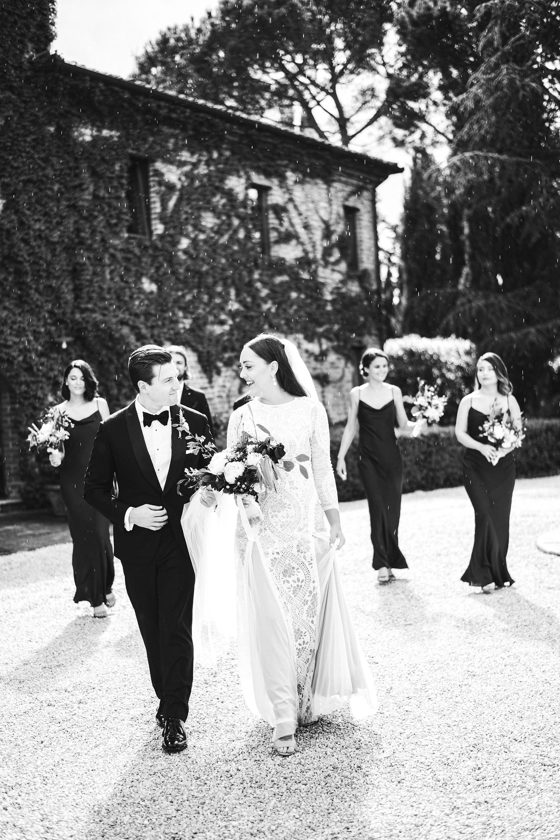Lovely walk tour of bride and groom just married at Villa l'Antica Posta venue in Umbria