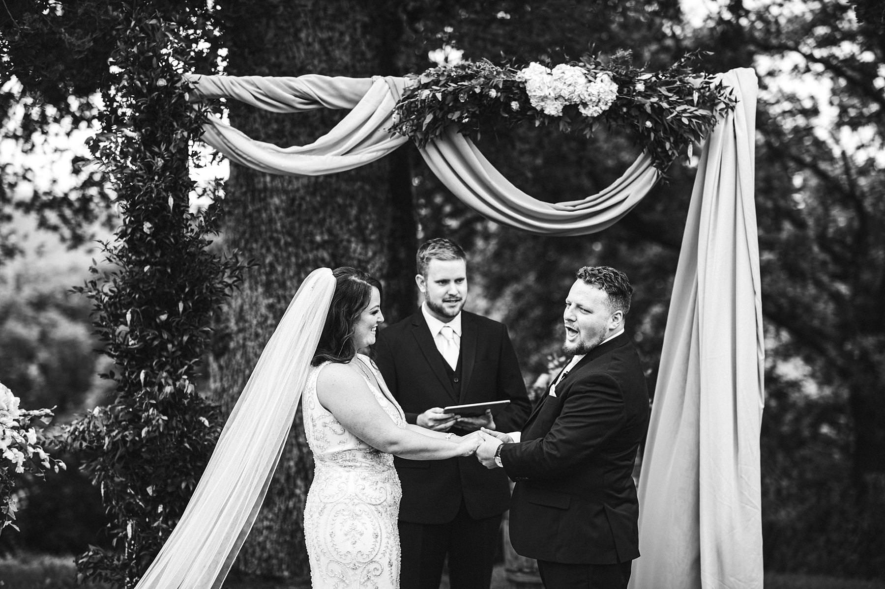 Lovely and emotional symbolic outdoor wedding ceremony at farmhouse Villa Le Bolli venue near Radicondoli