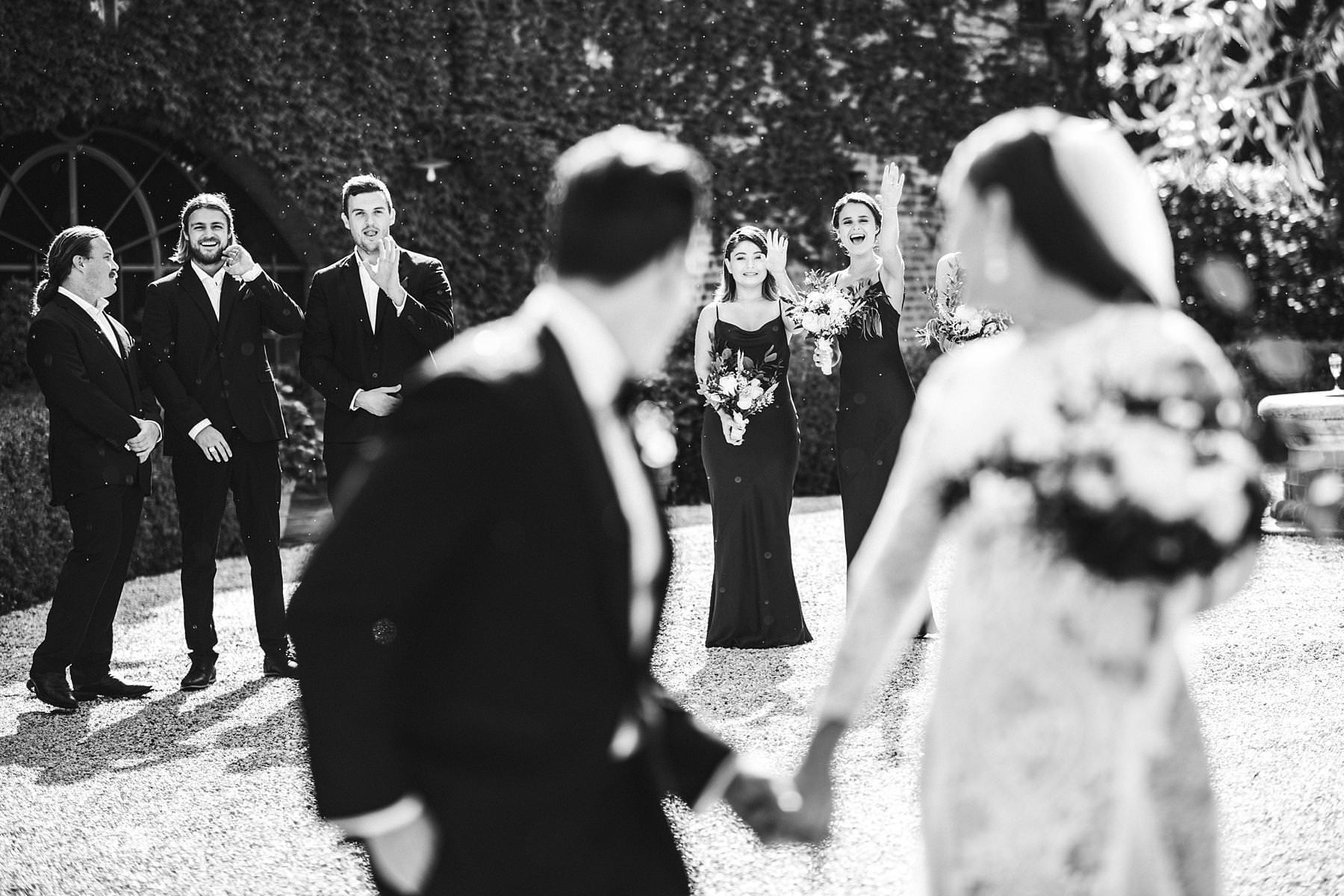 Exciting bridal party wedding photo at intimate destination wedding in Umbria at Antica Posta venue