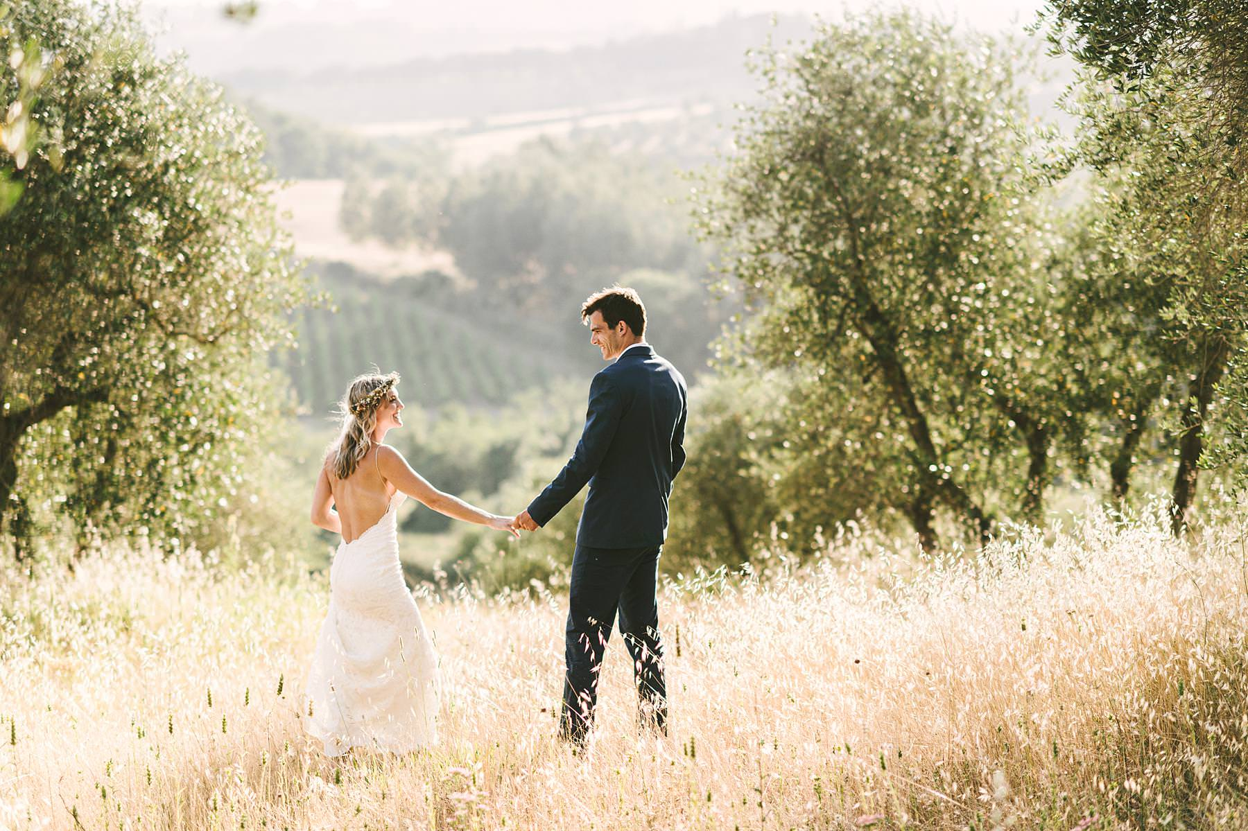 Lovely bride and groom wedding photo in olive groves of Tuscany at Villa La Torre in the comune of Montechiaro. Intimate destination wedding in Tuscany with Italian civil marriage at Roofless Abbey of San Galgano
