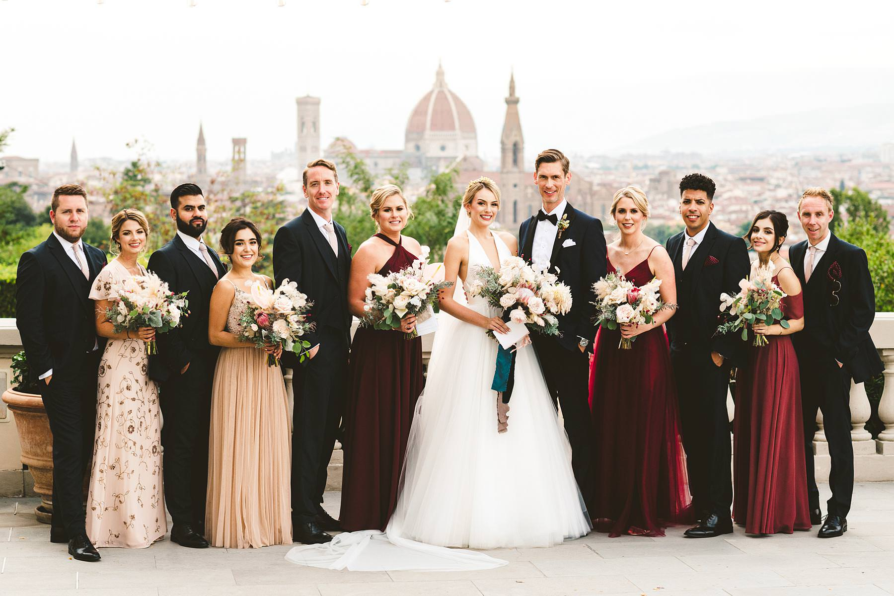 Villa La Vedetta, Florence. Fall in love with the view of the main terrace. Elegant destination wedding party group shoot at the venue. Bride in her Liancarlo gown and bridesmaids in BHLDN dresses. Groom in bespoke tuxedo