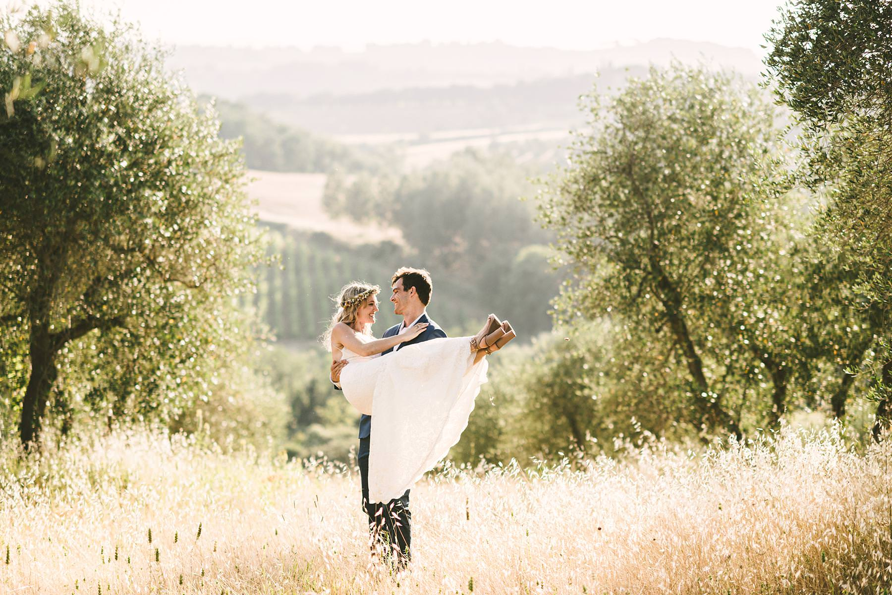 Romantic and lovely bride and groom wedding portrait in the warm, golden light of sunset at Villa La Torre country house located in the Montechiaro countryside area