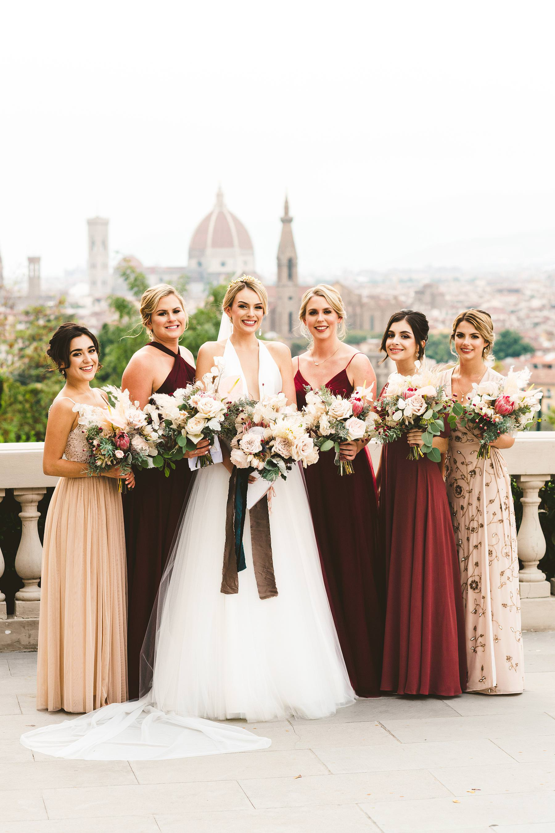 Luxury wedding with amazing view at Villa La Vedetta in Florence. Bride Christina with bridesmaids