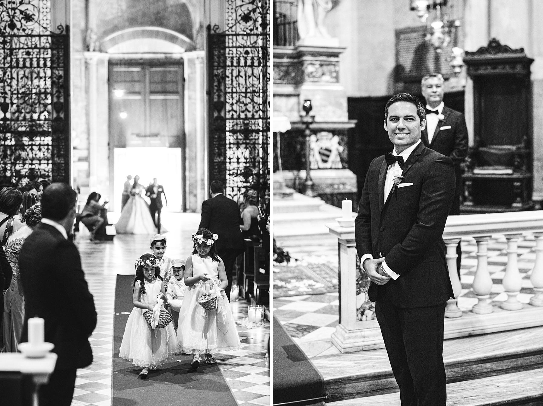Lovely flower girls walks down the aisle in the Arezzo Cathedral. Elegant destination wedding in Arezzo and Valenzano Castle