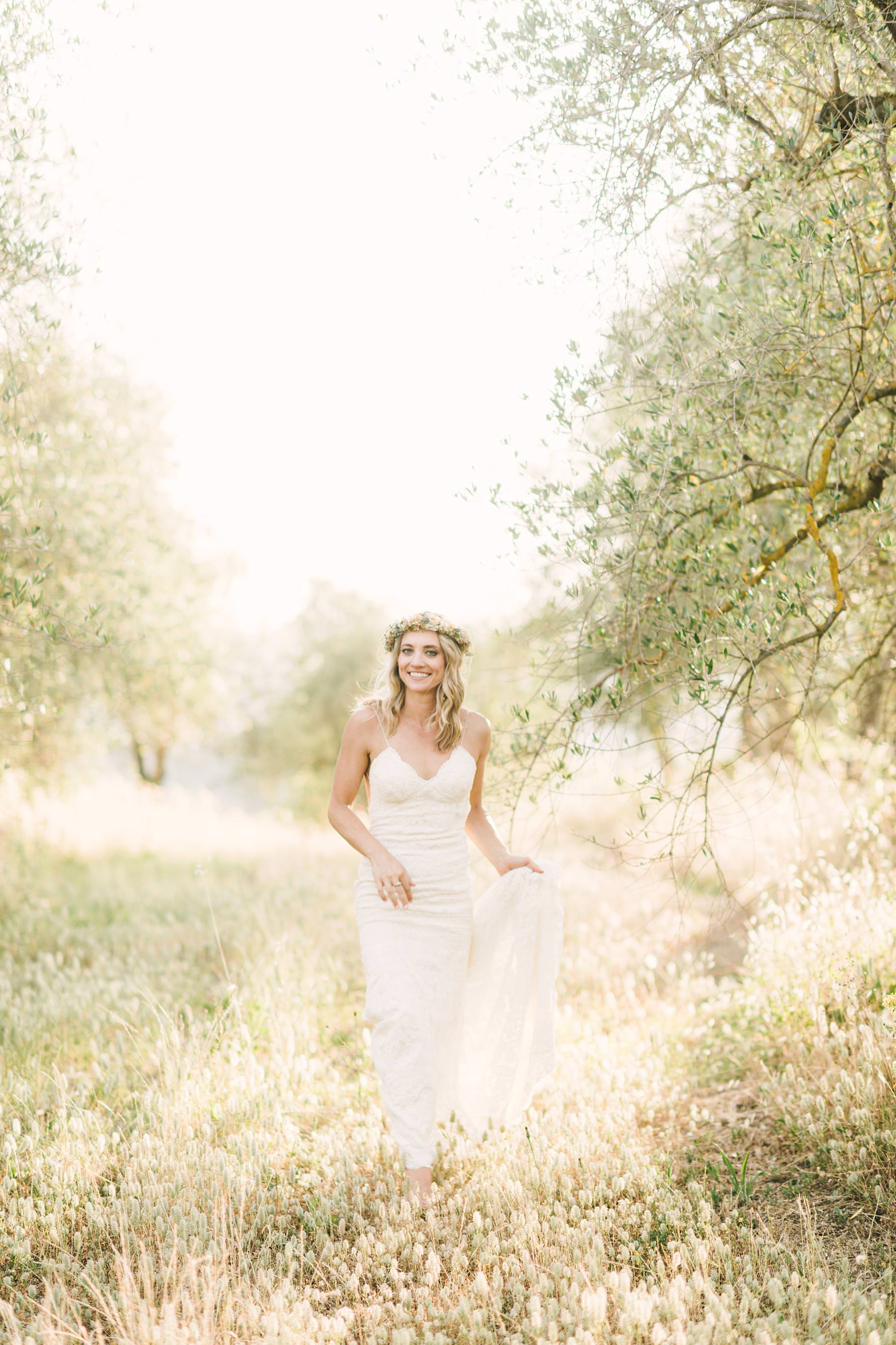 Lovely bridal Amelia portrait in the middle of the tuscan countryside olive groves field at Villa La Torre in the Montechiaro area