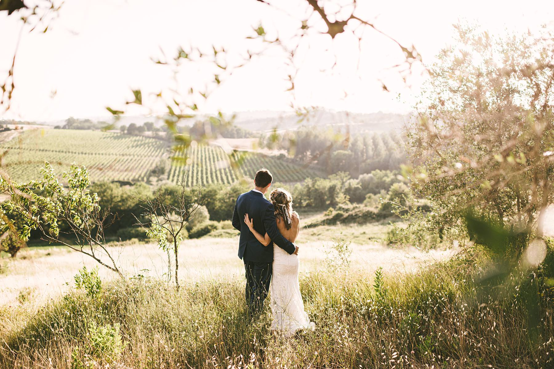 Intimate destination wedding portrait in the warm, golden light of sunset at Villa La Torre country house located in the Montechiaro countryside area