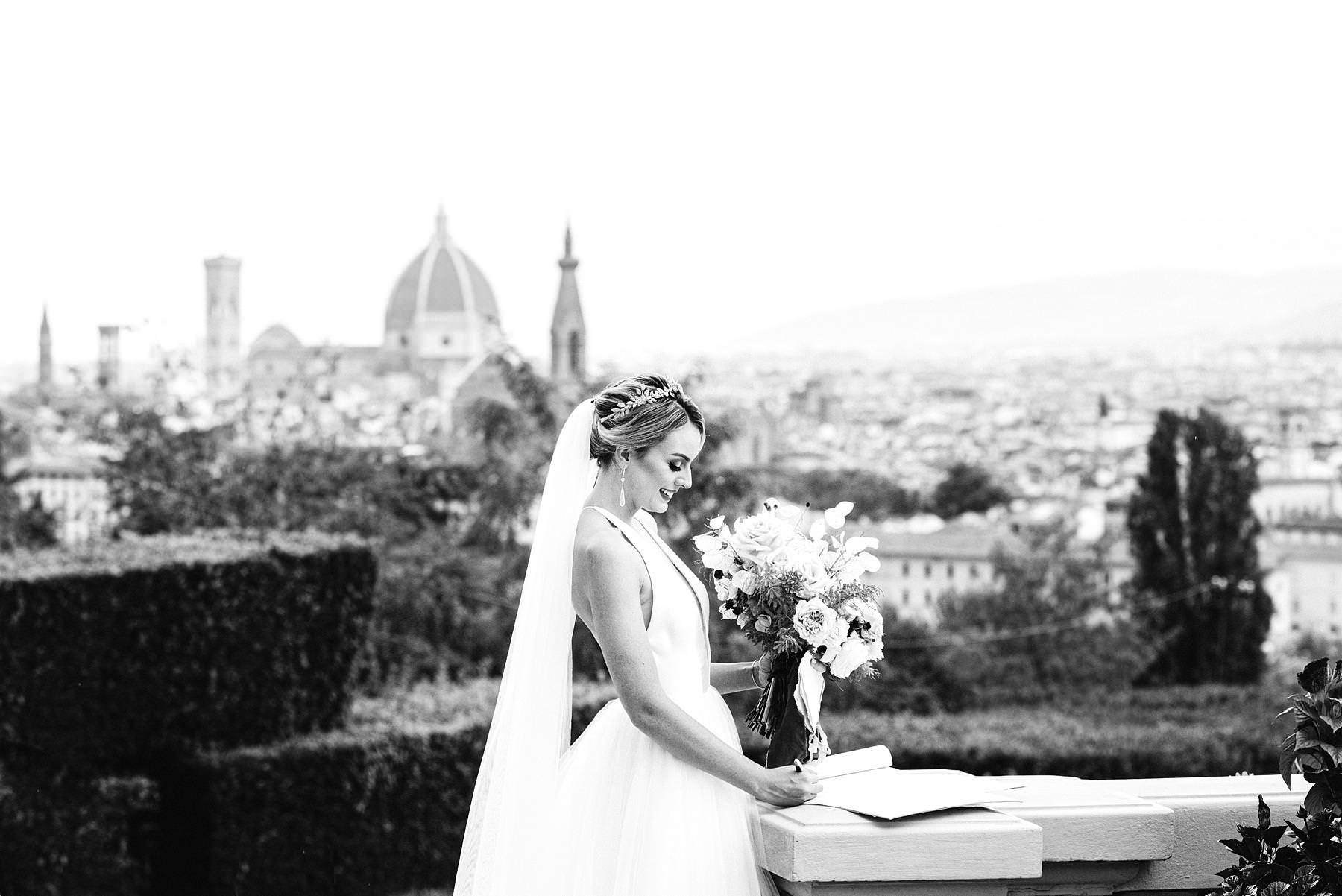 Luxury wedding with amazing view at Villa La Vedetta in Florence. Elegant, romantic and timeless bride in her Liancarlo wedding gown