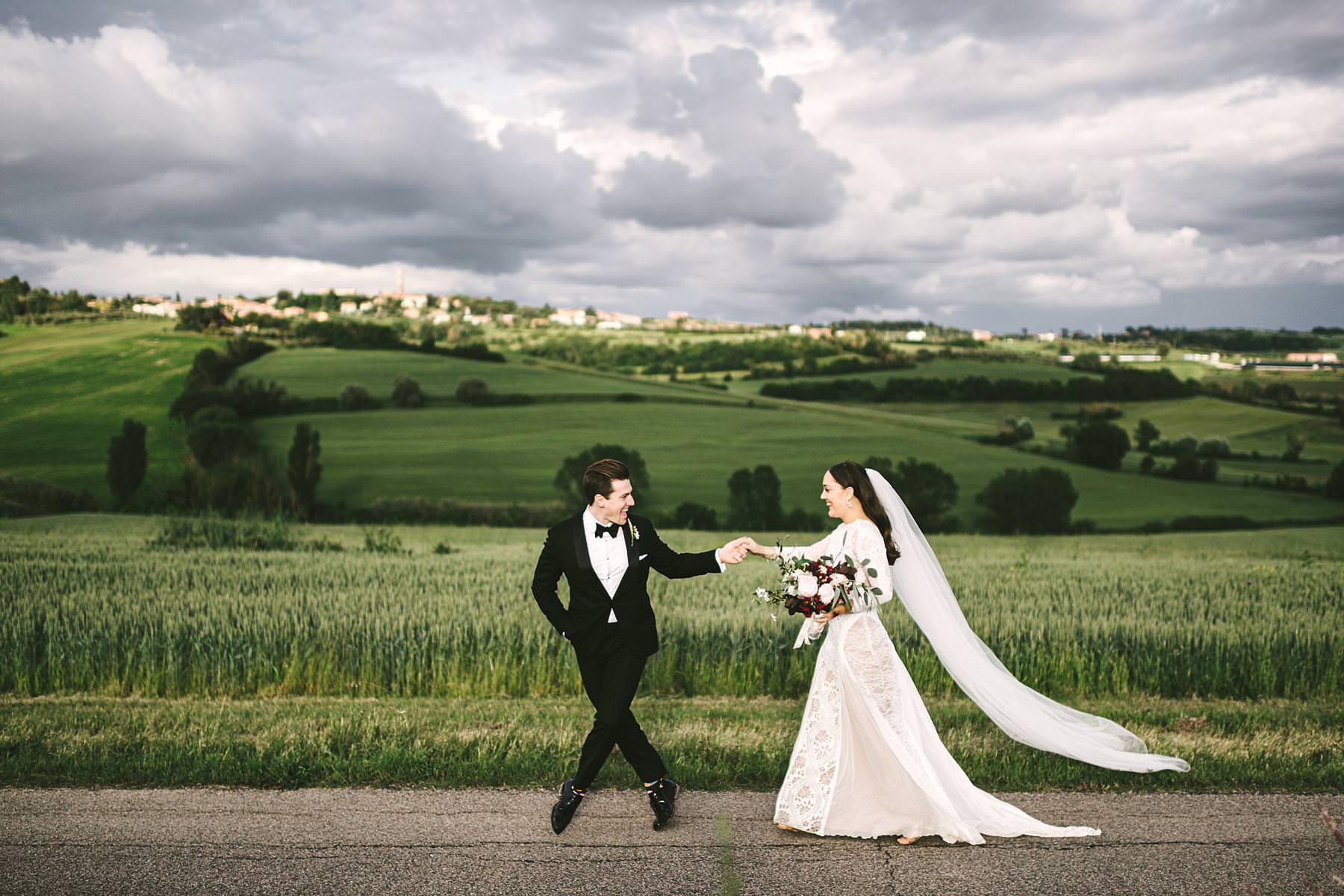 Bride and groom wedding portrait in Umbria near Villa l'Antica Posta. Elegant and exciting symbolic wedding in Italy