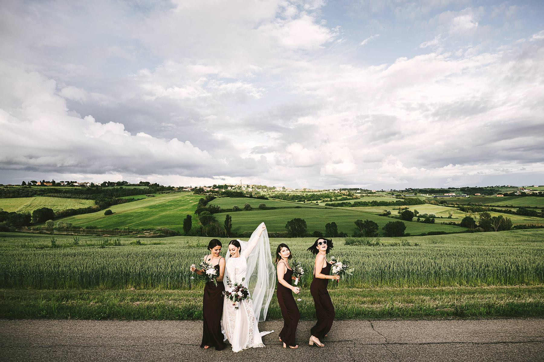 Gorgeous bride and bridesmaid wedding photo with amazing Umbria landscape countryside view near historic Villa l'Antica Posta venue