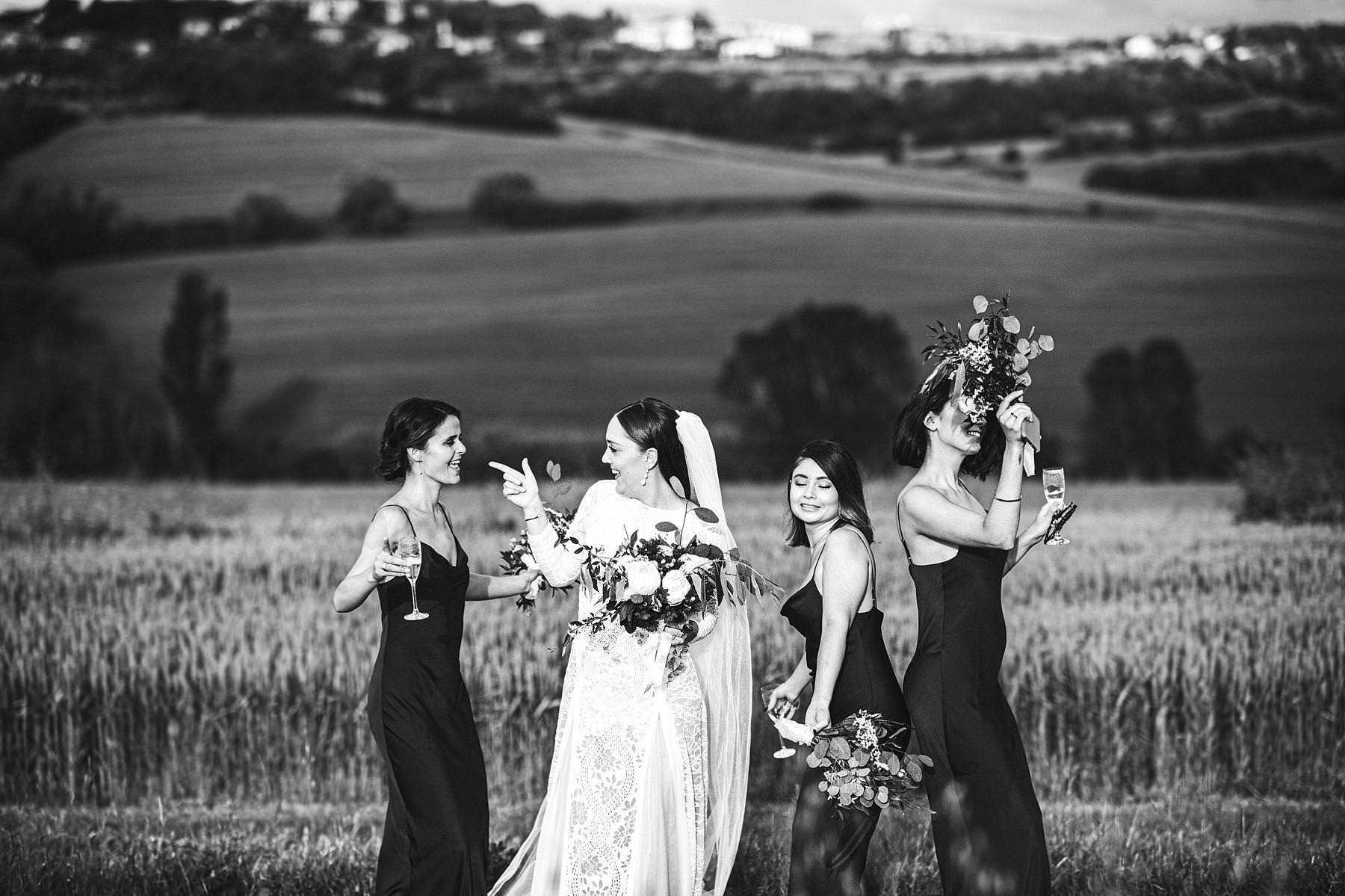 Gorgeous and funny bride and bridesmaid wedding photo with amazing Umbria landscape countryside view near historic Villa l'Antica Posta venue