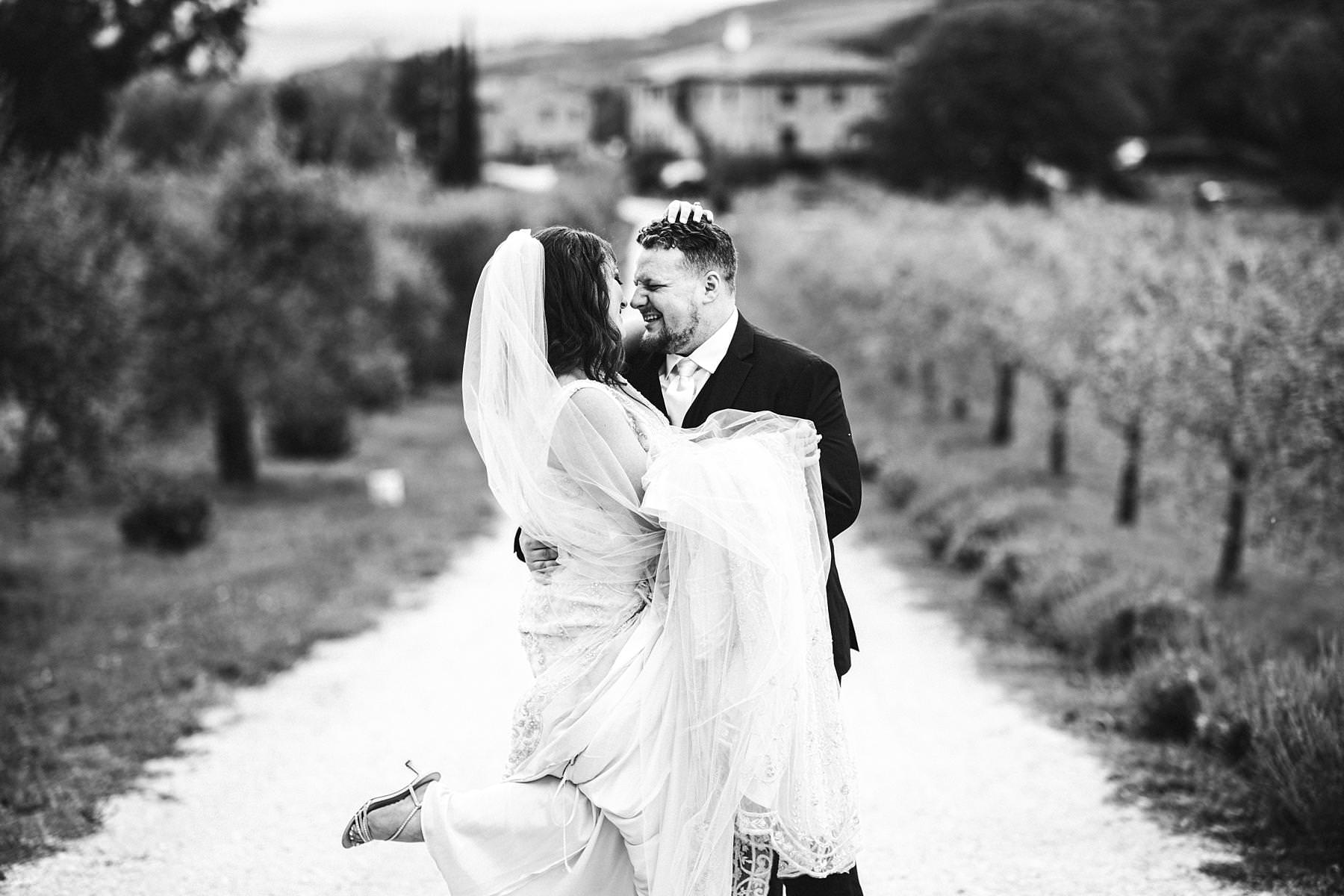 Lovely and spontaneous bride and groom wedding portrait in Villa Le Bolli destination wedding venue near Radicondoli town