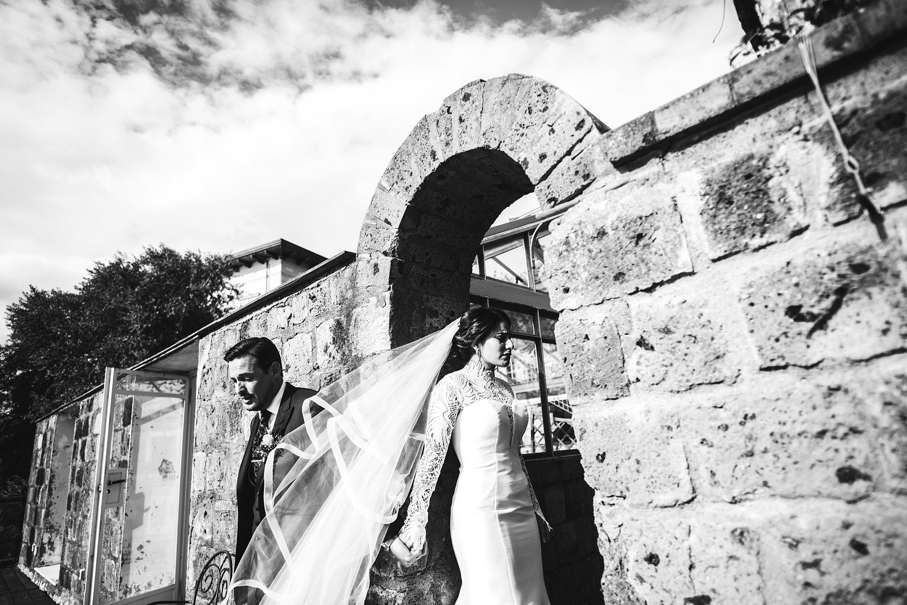 Evocative and unforgettable bride and groom first ÒblindÓ look just before the outdoor wedding ceremony at Villa Angelina in Sorrento