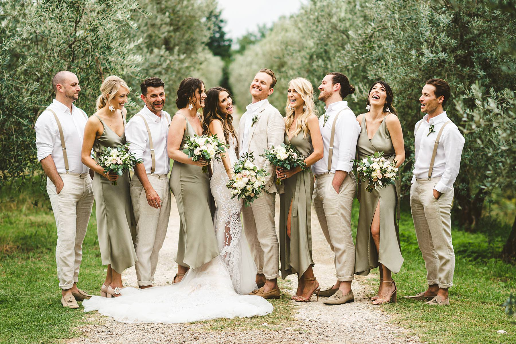 Elegant and beautiful bridal party group shoot at the historic residence of Villa Il Poggiale. Modern and unusual wedding framed by the olive groves of Chianti