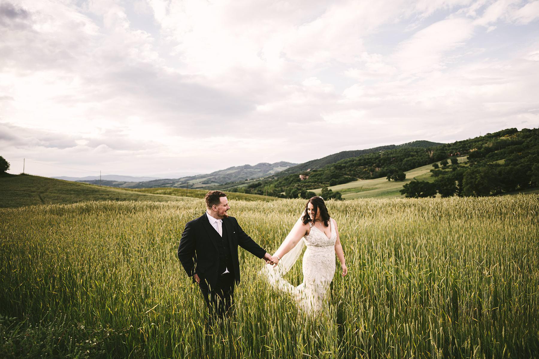 Blissful and intimate destination wedding at Villa Le Bolli, Tuscany. Unforgettable bride groom wedding portrait in the countryside of Tuscany near Radicondoli