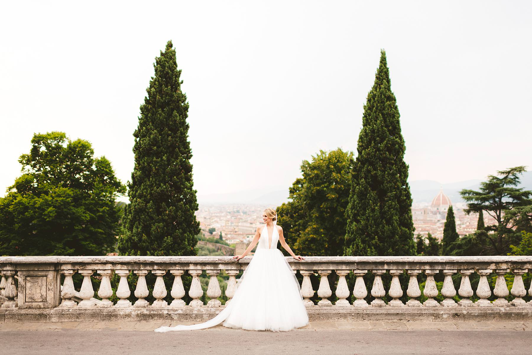 Lovely bride in her Liancarlo wedding gown with a golden tiara which make her a real princess. Bridal portrait in Florence at San Miniato al Monte area. Intimate luxury destination wedding in Florence at Villa La Vedetta