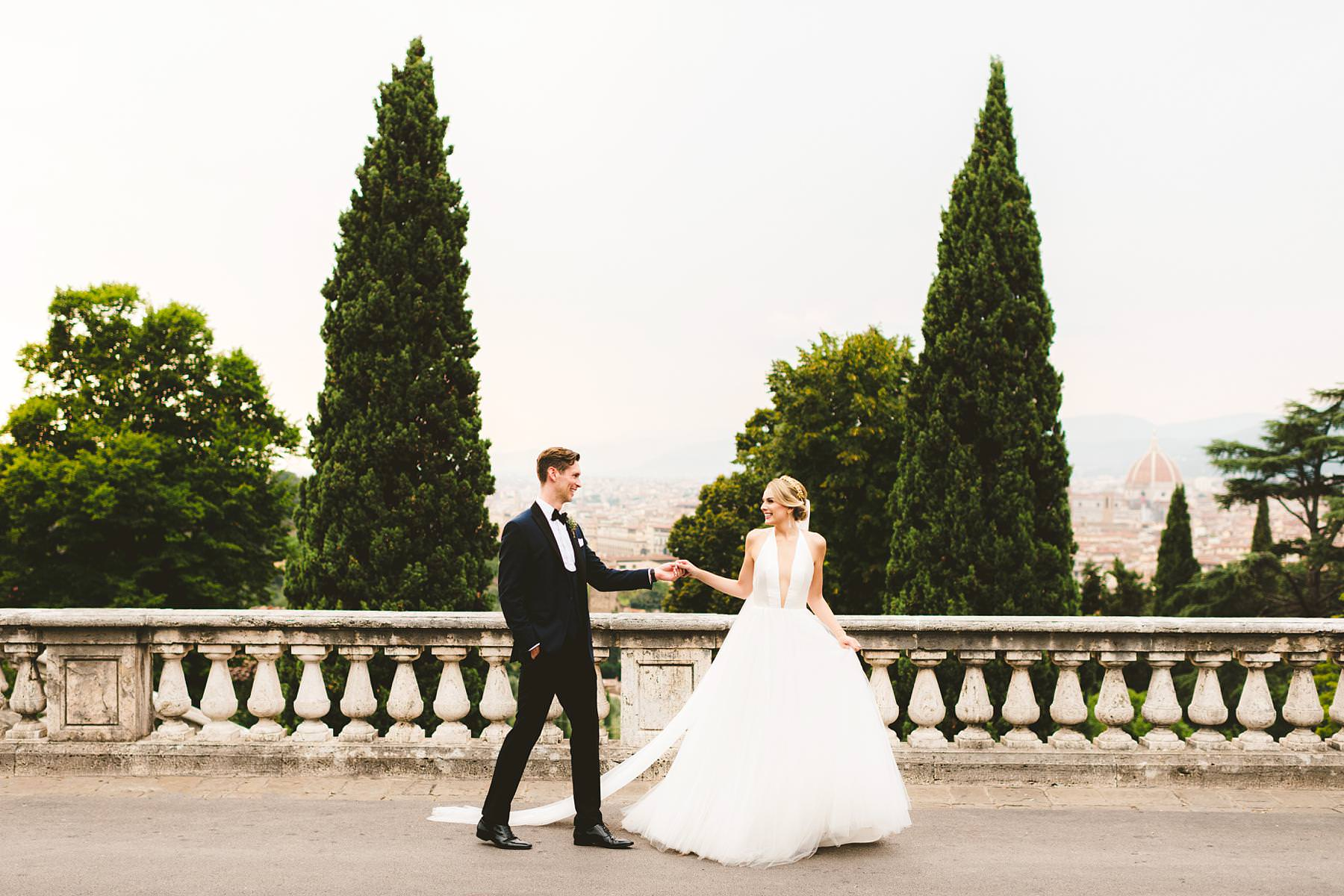 Lovely wedding photo of bride Christina in her Liancarlo wedding gown with a golden tiara which make her a real princess with groom Cheyne in his bespoke tuxedo. Intimate luxury destination wedding in Florence at Villa La Vedetta