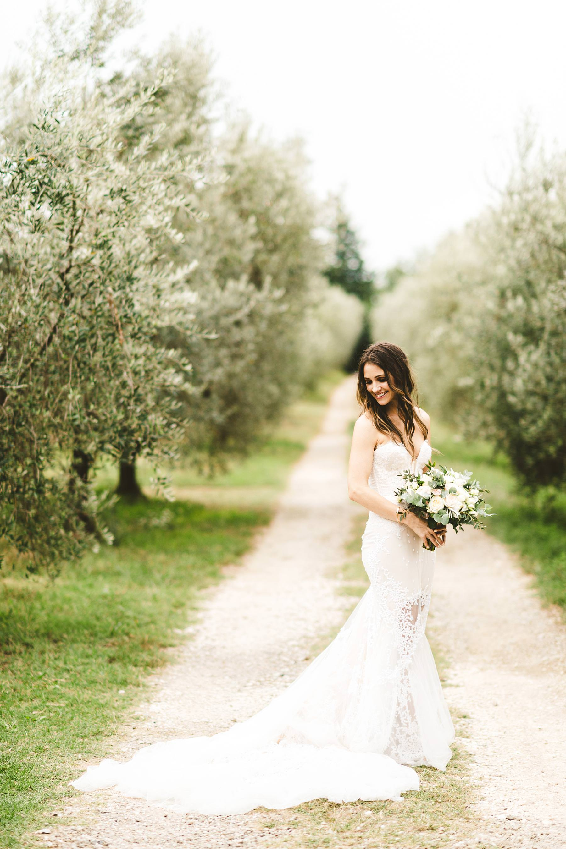 Beautiful bridal portrait in a white street in the olive groves of Chianti near the historical residence of Villa Il Poggiale