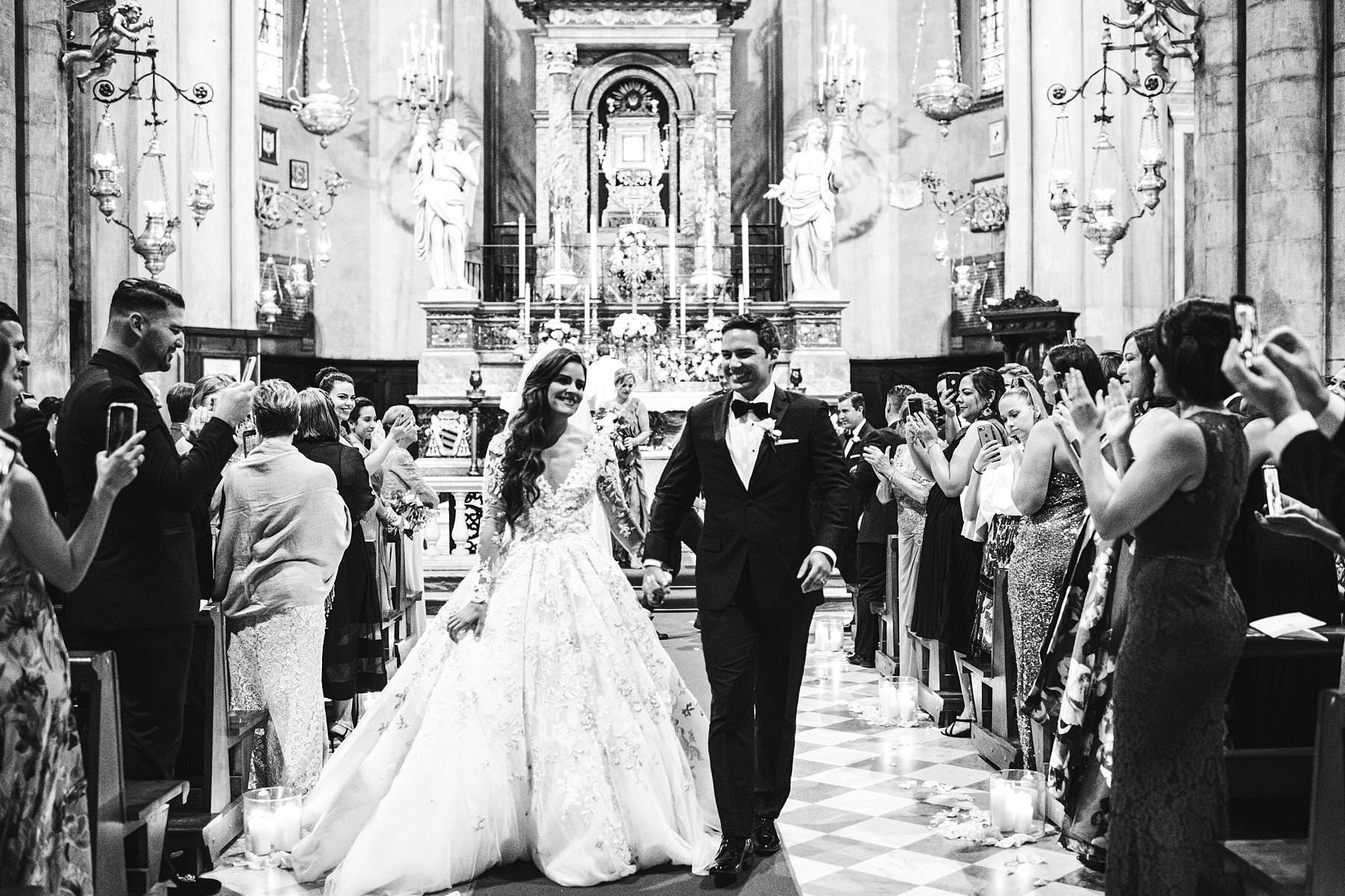 Bride and groom are just married in Arezzo Cathedral in Tuscany