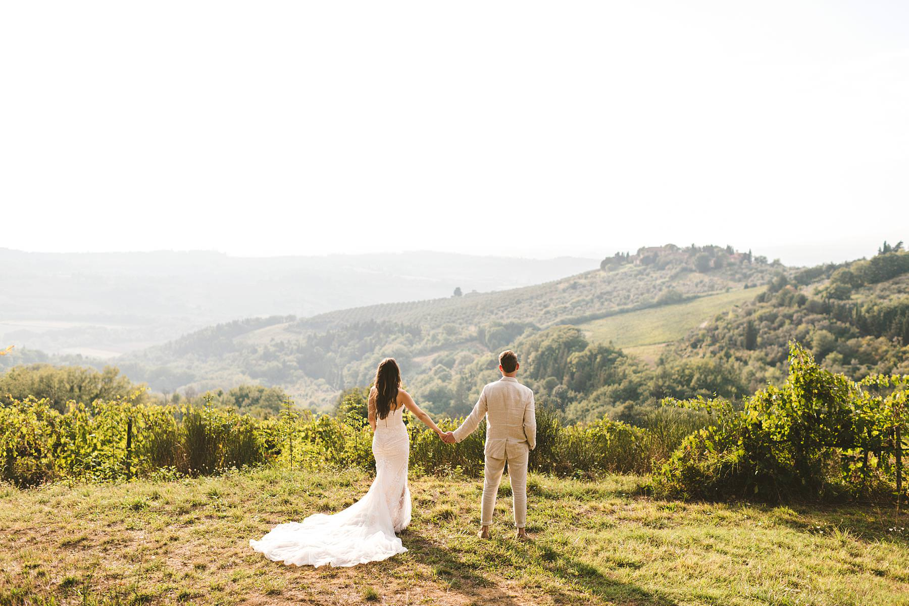 Elegant and beautiful bride and groom wedding photo surrounded by the Chianti countryside of Tuscany at the Villa Il Poggiale historic residence