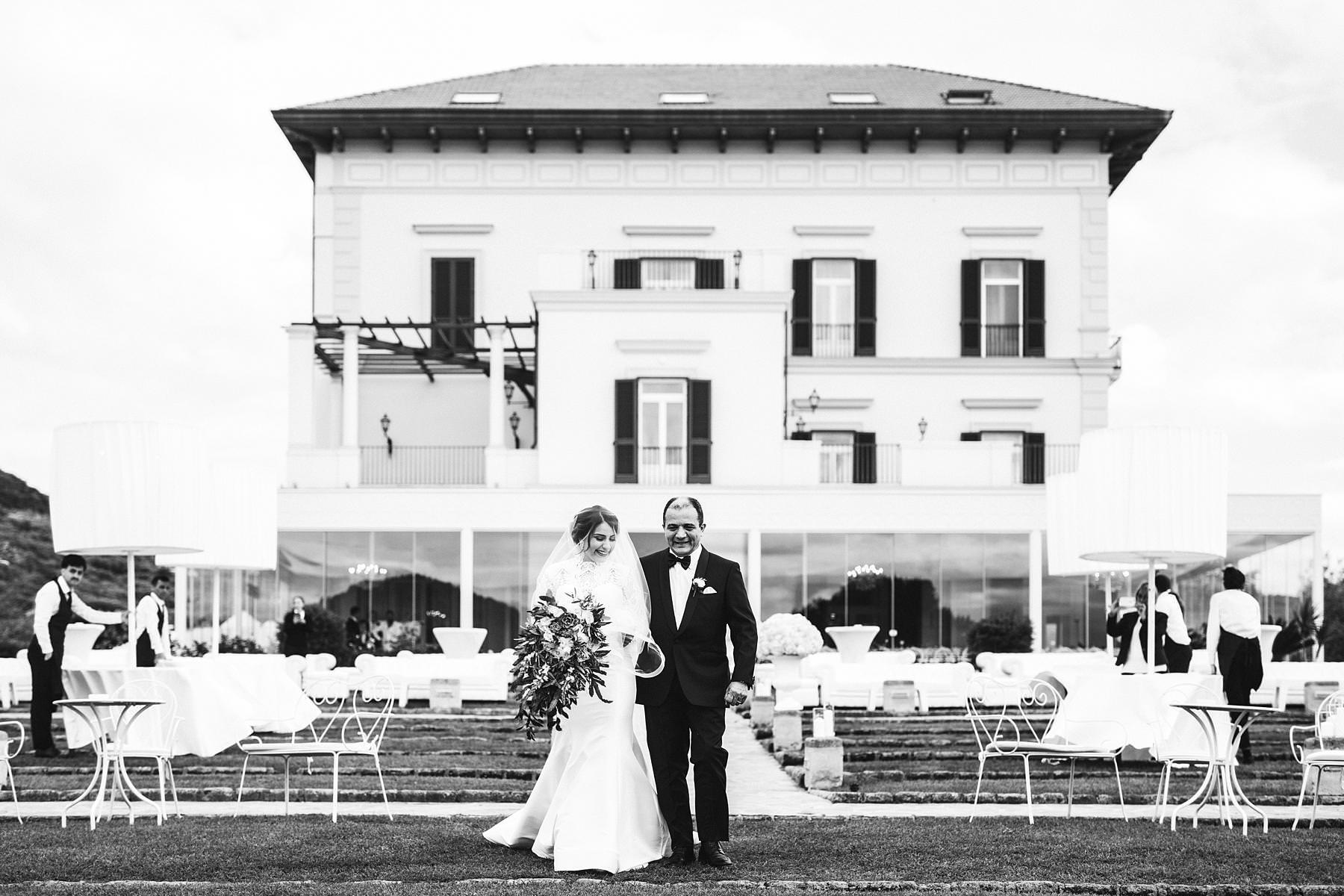 Bride Steffany walks down the aisle in Villa Angelina in Sorrento