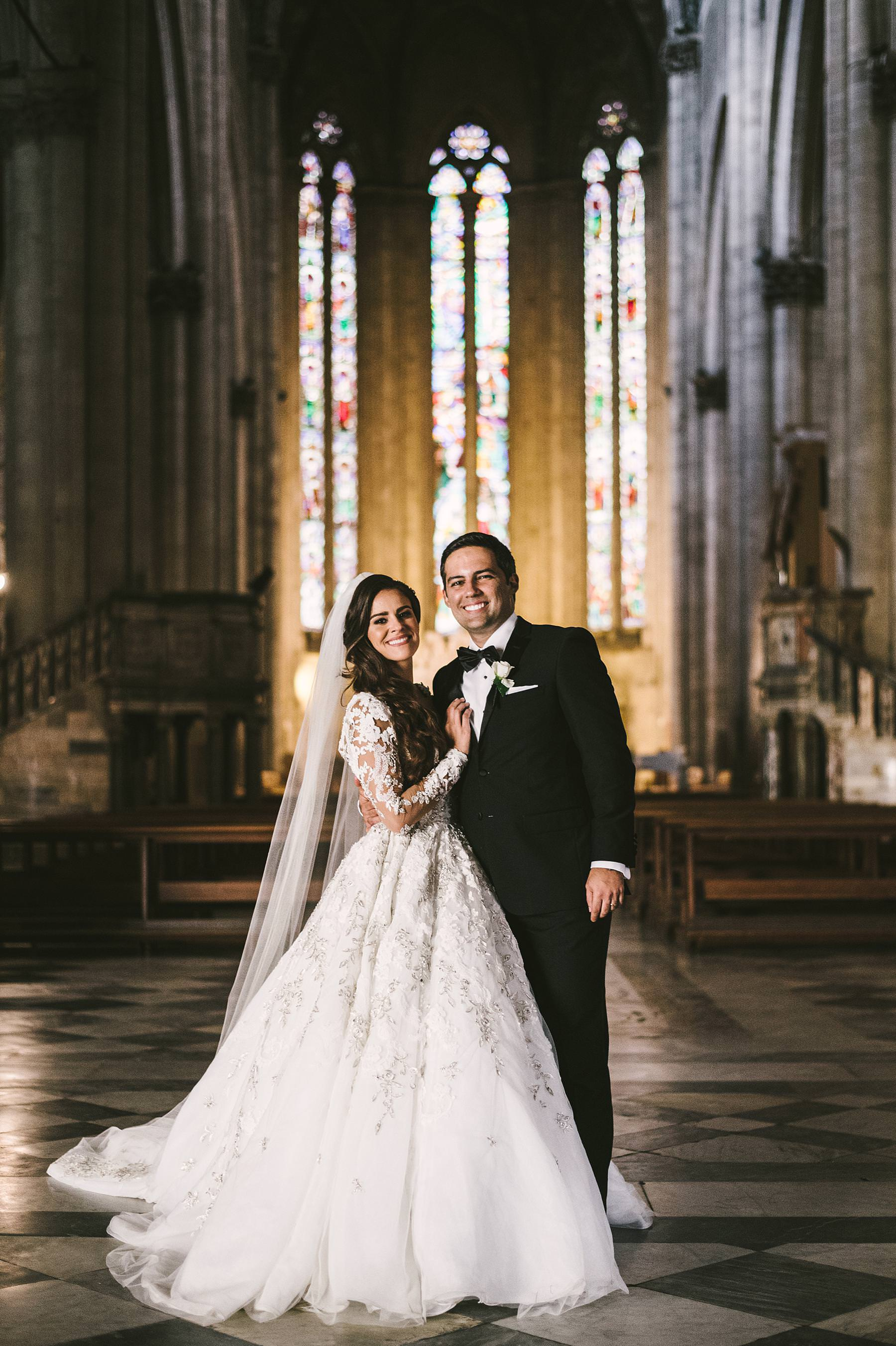 Lovely bride and groom wedding portrait inside the gorgeous Cathedral of Arezzo