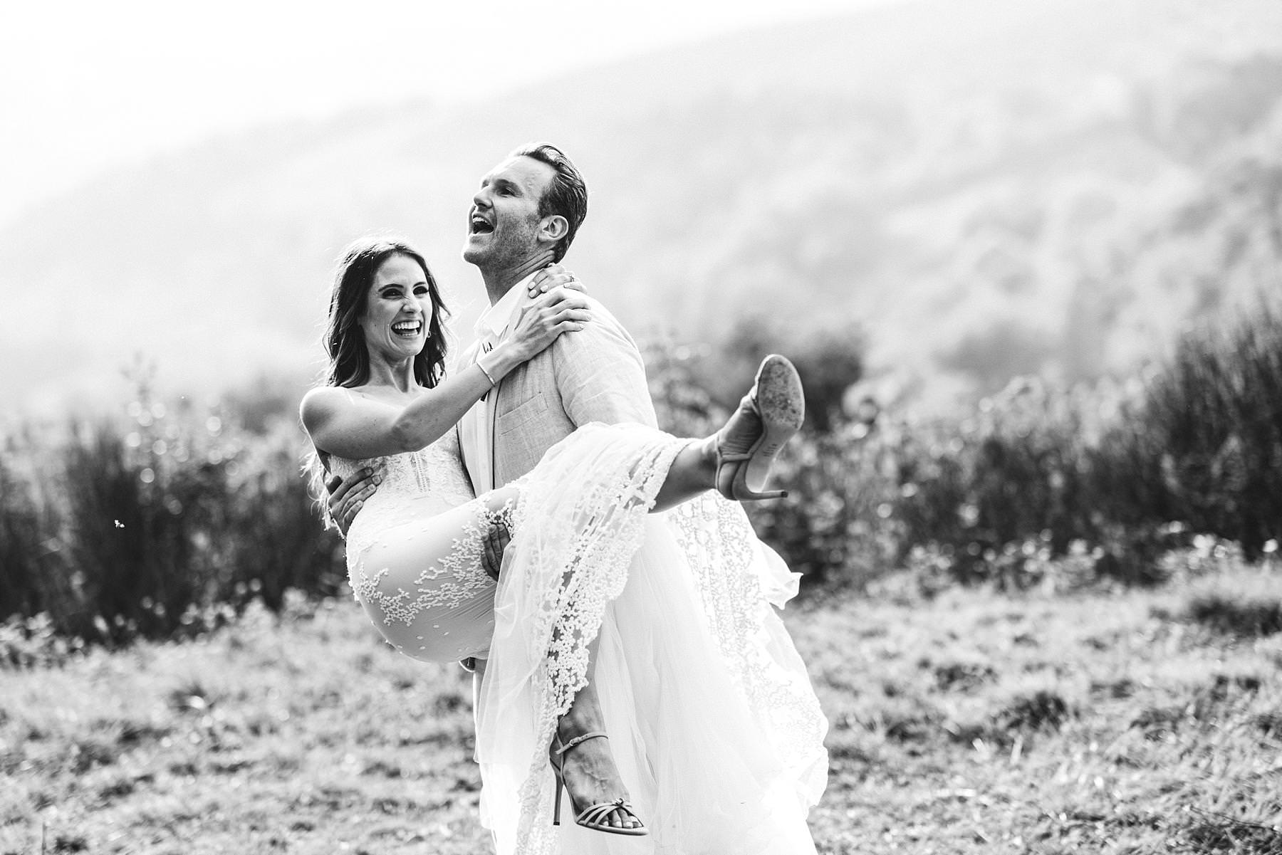 Lovely genuine moment of bride and groom in the vineyard of Chianti near historic residence of Villa Il Poggiale